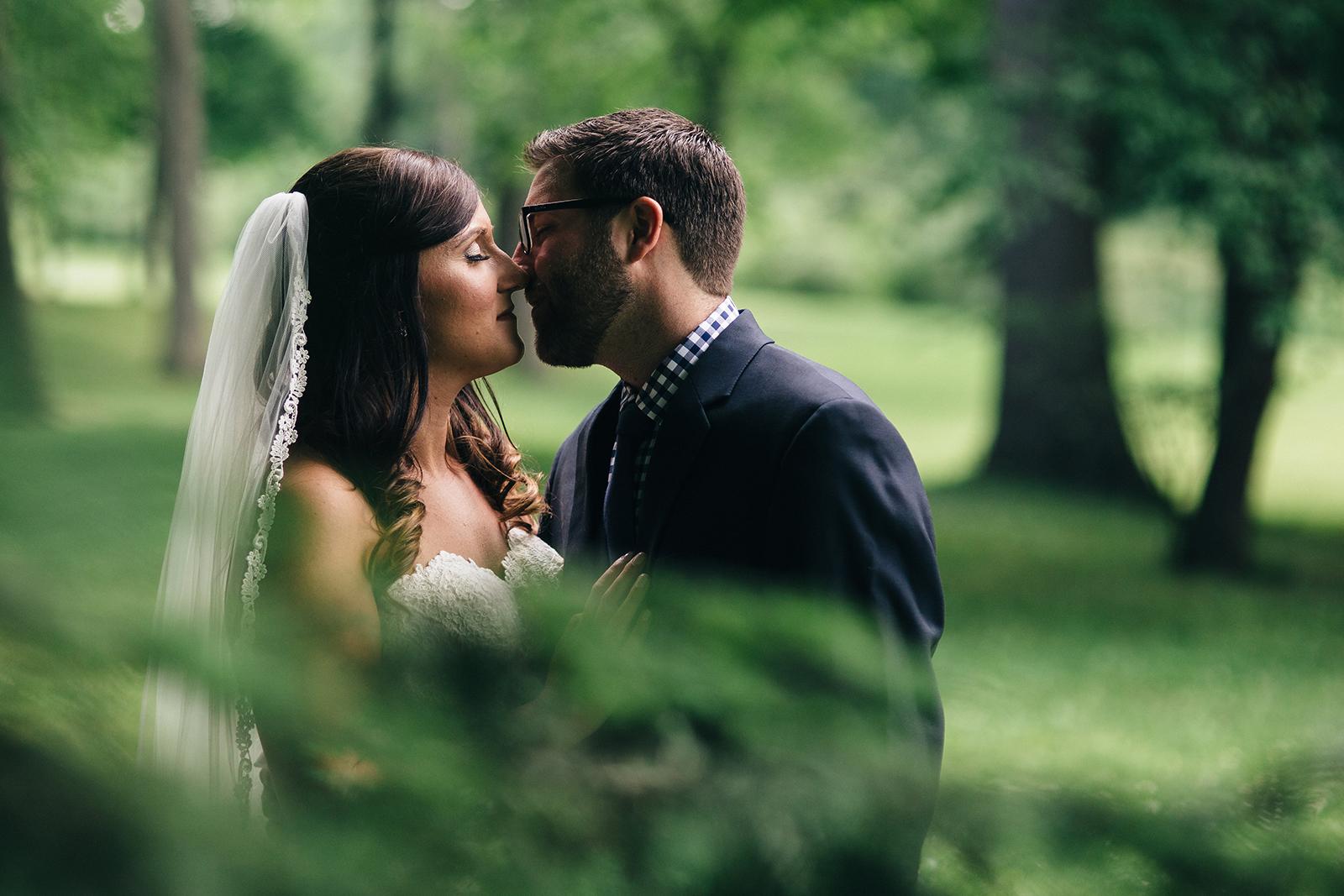 Toledo, Ohio wedding photography of bride and groom kissing.