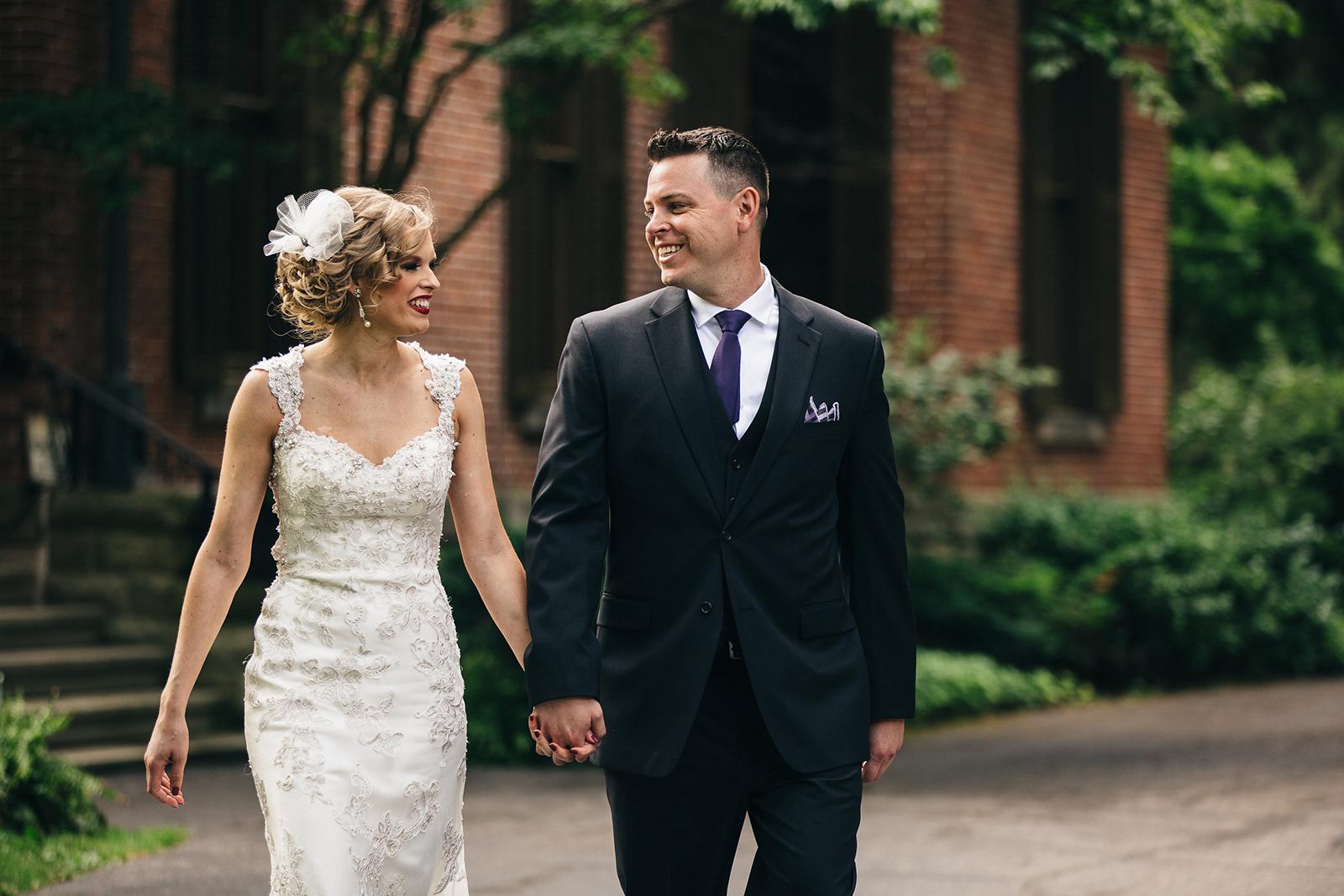 Bride and groom walking through a park on their wedding day in Sandusky, Ohio.