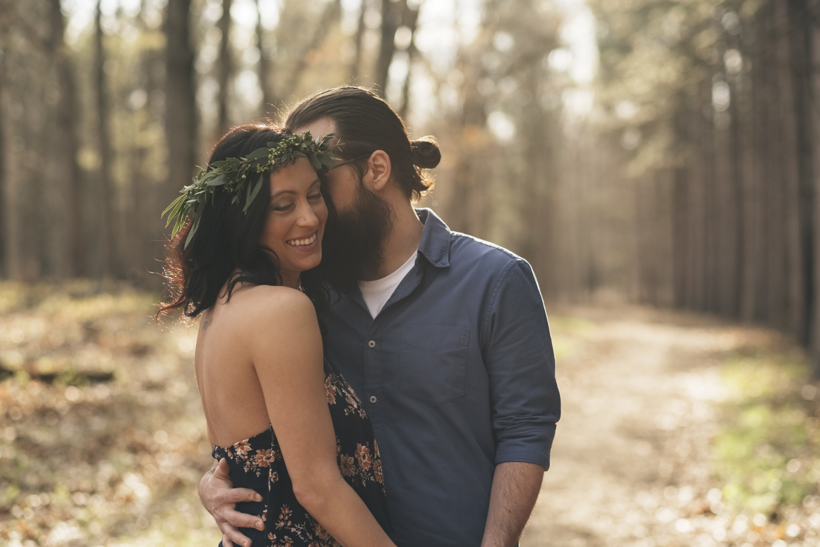 Couple laughing and kissing during engagement session in Ohio.