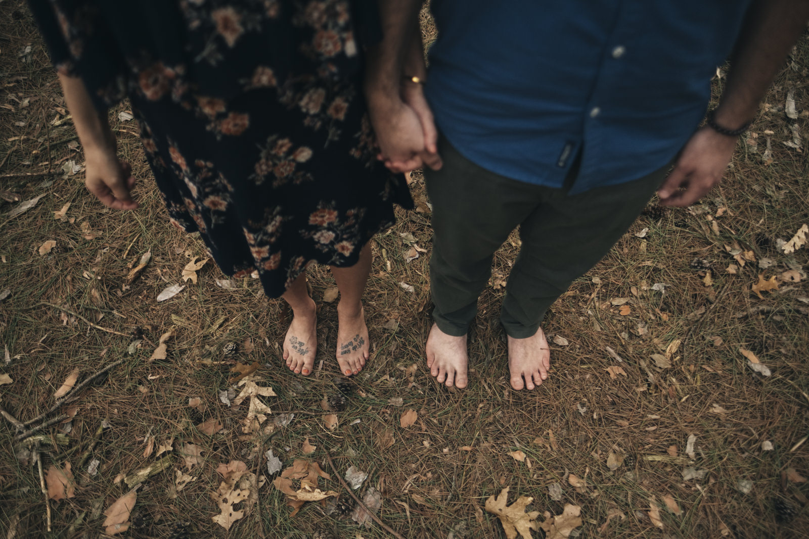 Couple goes barefoot for their engagement session in the woods in Toledo, Ohio.