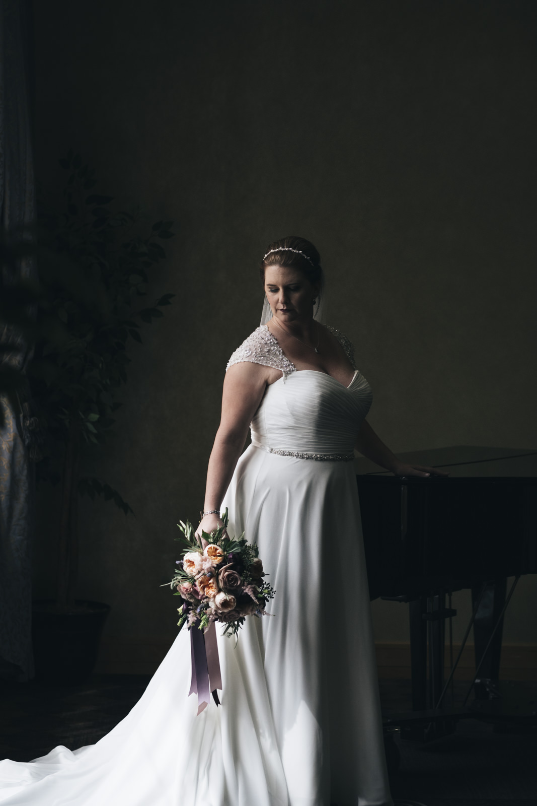 Stunning bride in a dress from Belle Amour Bridal.