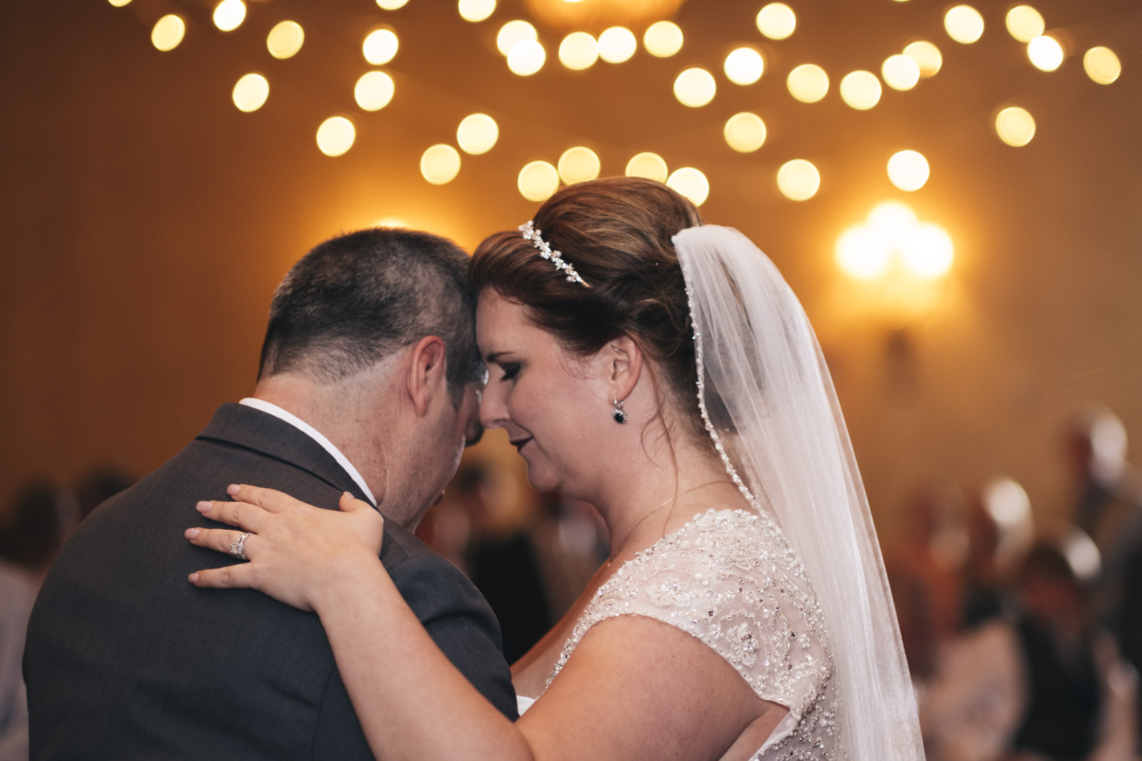 First dance with beautiful lighting from Mager Designs in Toledo, Ohio.