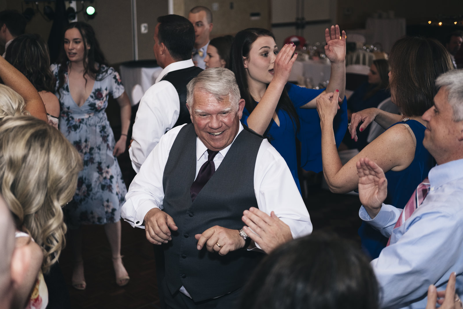 Father of the Groom dancing at wedding reception.
