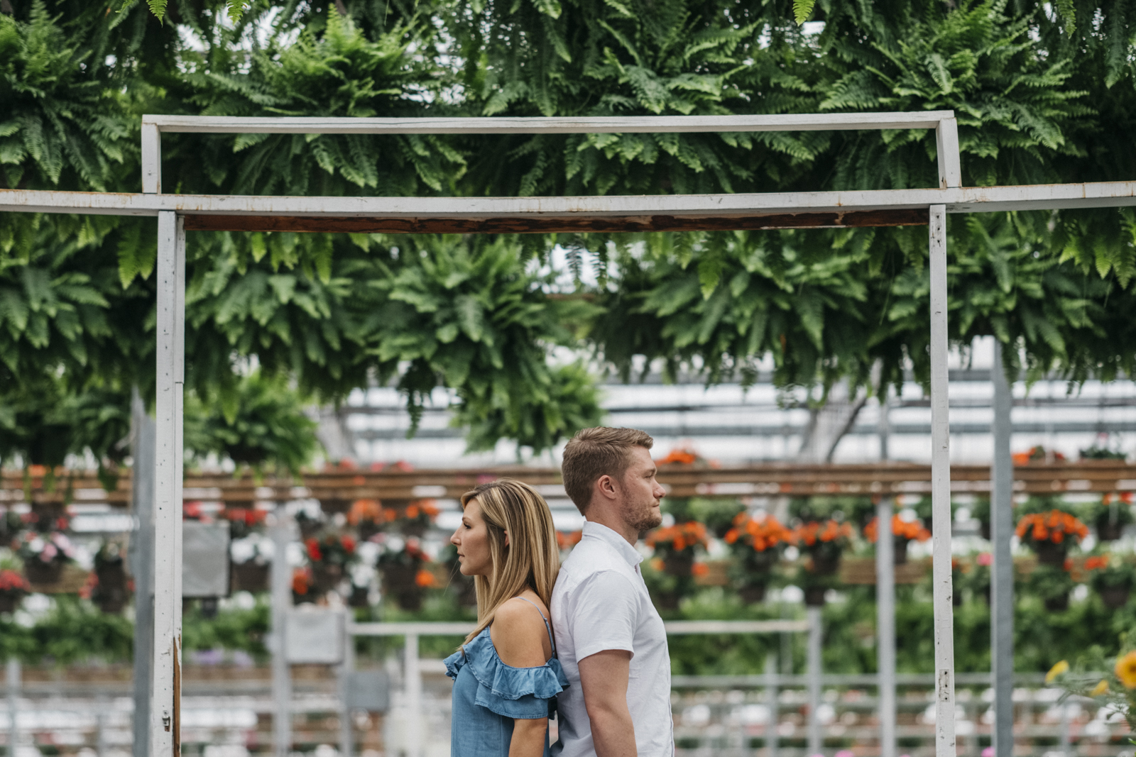 Spring engagement session at Hecklinger Greenhouse in Toledo, Ohio.