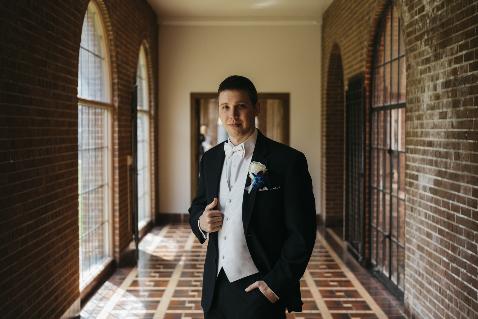 Wedding photography of groom on wedding day in Plymouth, Michigan.