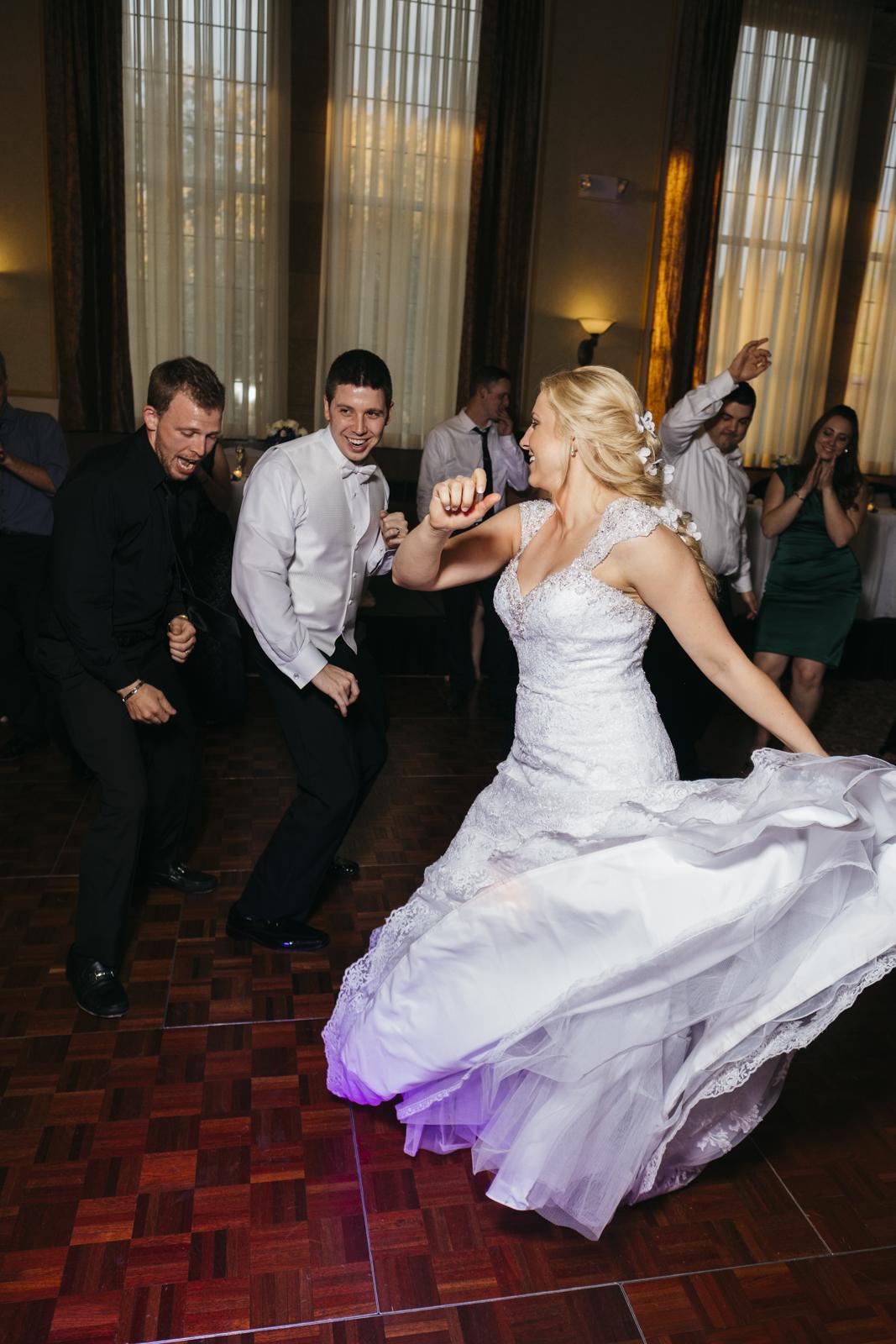 Bride and groom dancing at wedding reception.