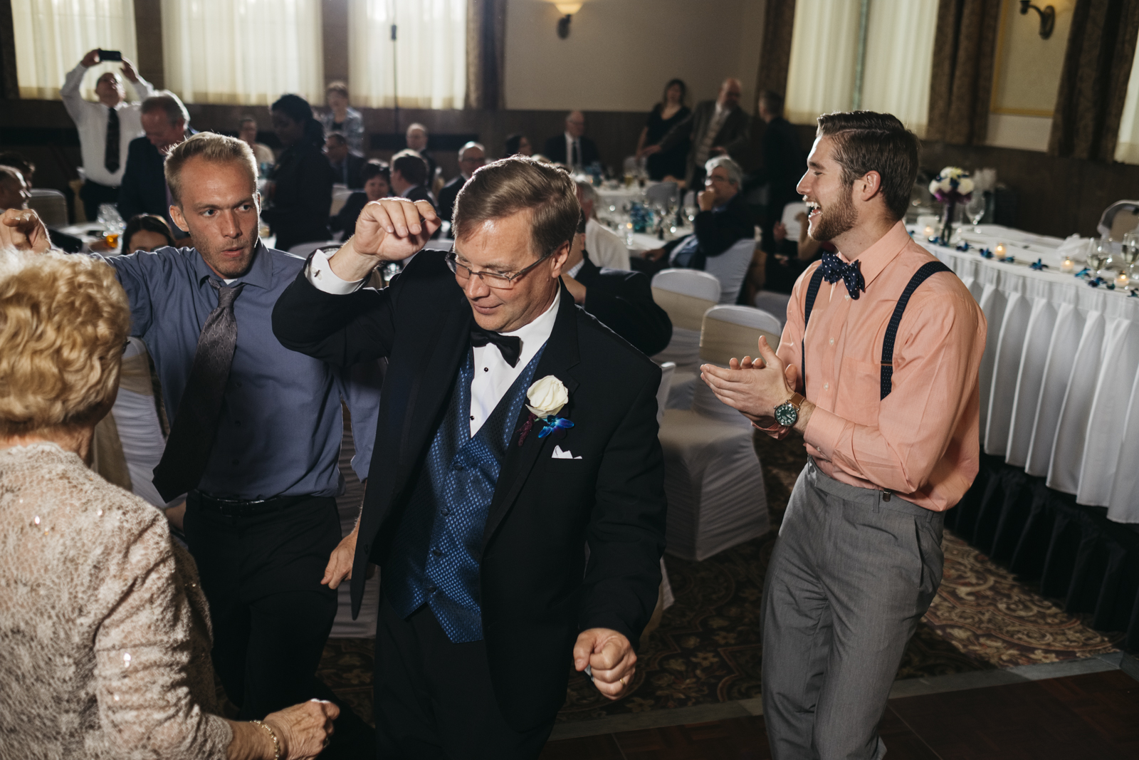 Father of the bride dancing at the wedding reception.