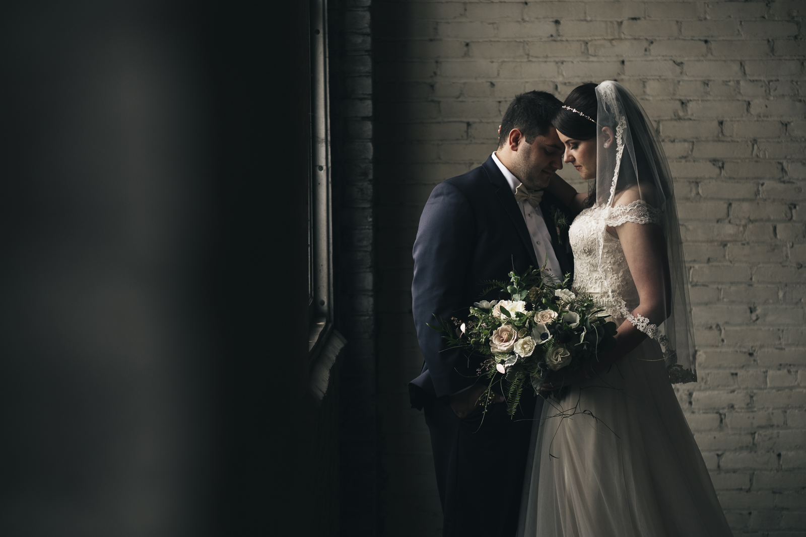 Bride and groom portrait in downtown Toledo warehouse.