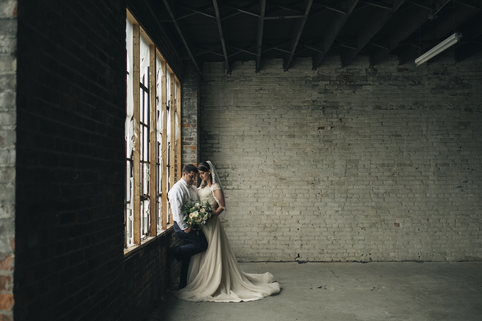 Bride and groom wedding photography in downtown Toledo Warehouse.