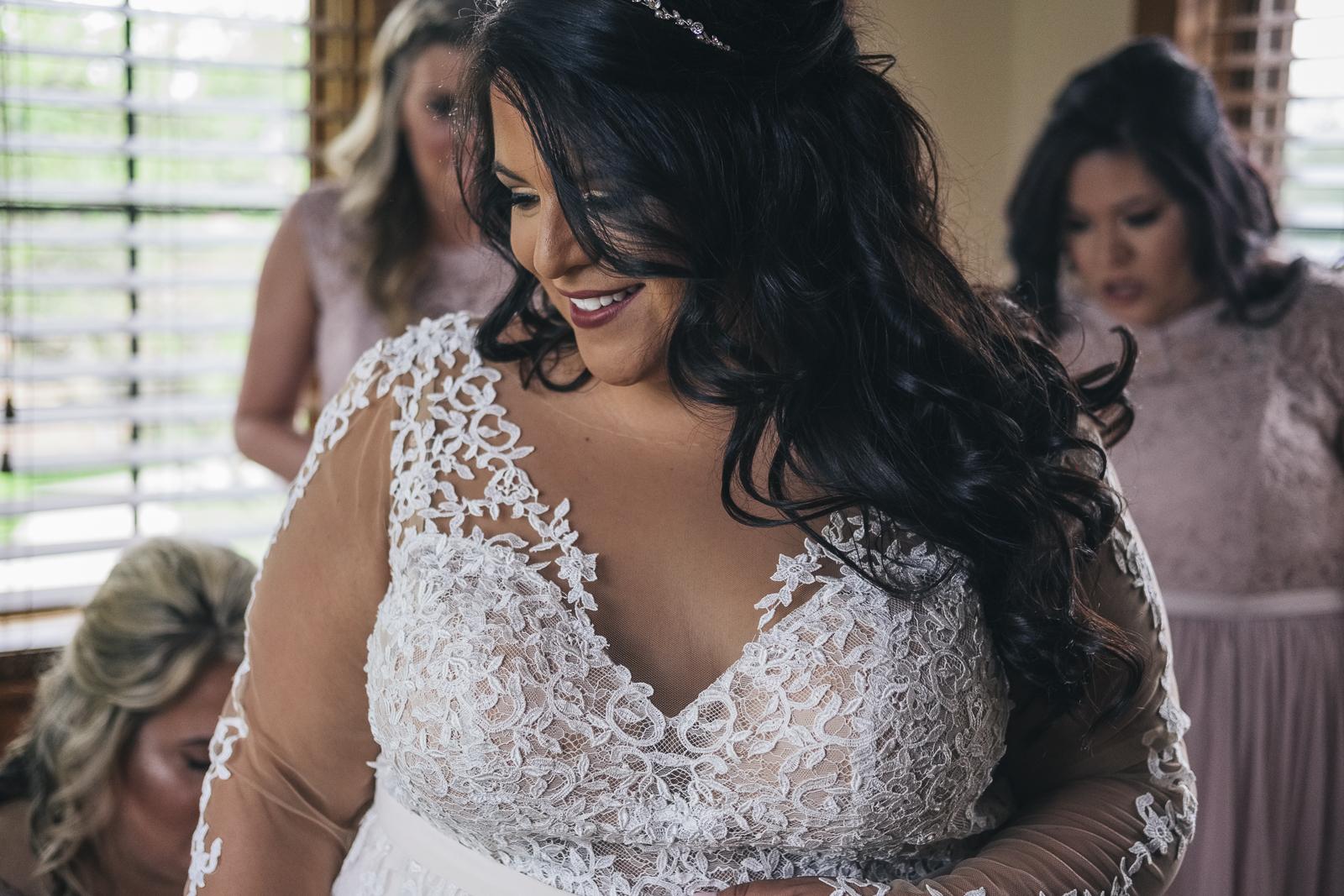Bride in lace wedding dress at Nazareth Hall.