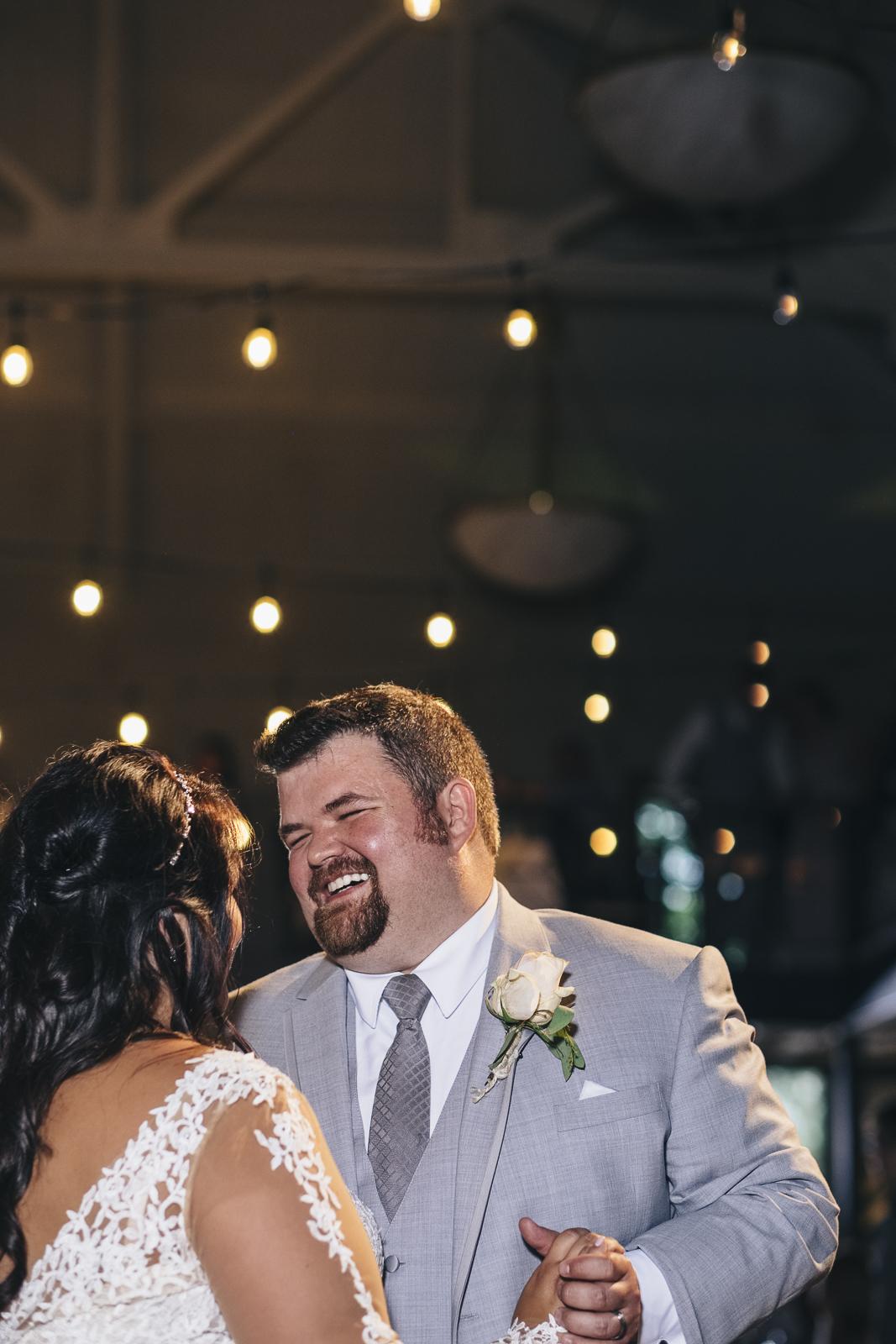 Groom during first dance at Nazareth Hall wedding reception.
