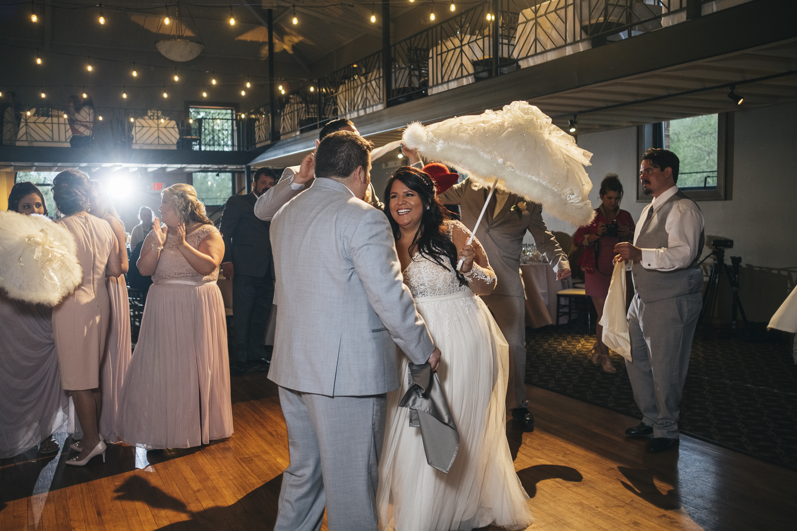 Bride and groom do Second Line, New Orleans Wedding tradition, at their wedding reception.