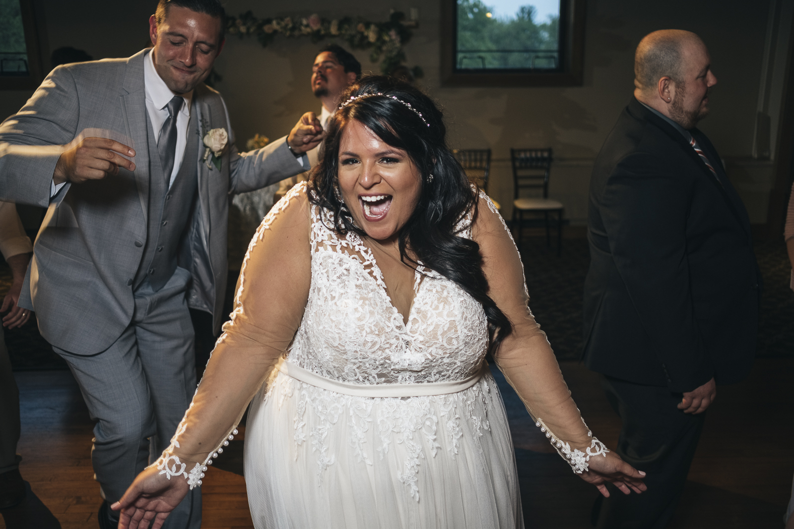 Bride dancing to bookthatdj.com wedding DJ at Nazareth Hall.