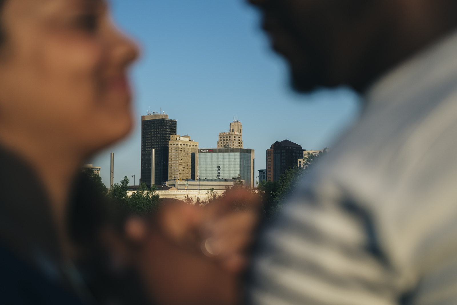 Engagement session with Toledo skyline in the background.