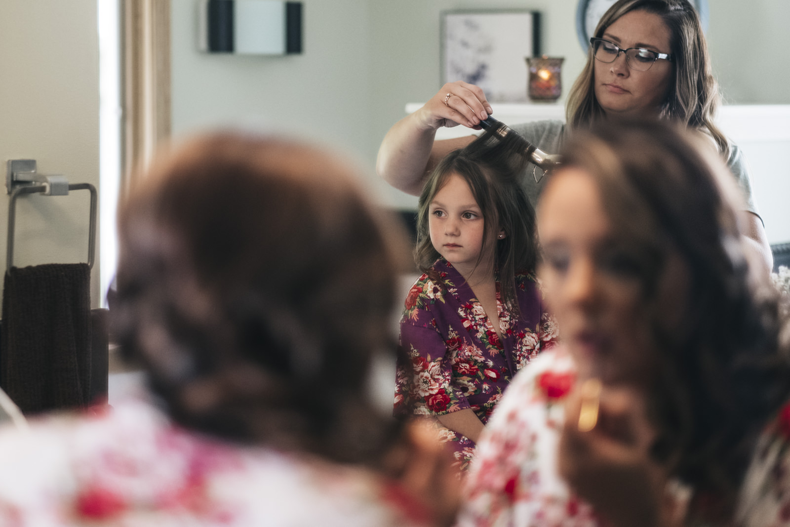 Bride's daughter getting ready for wedding day.