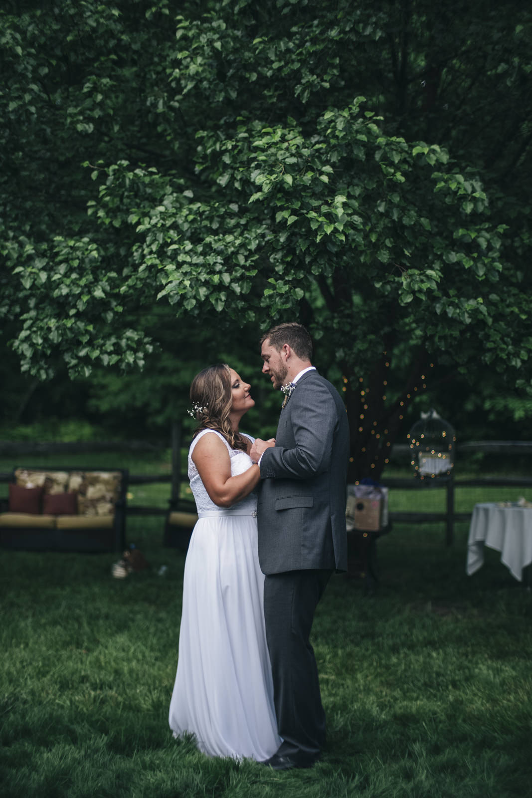 Bride and groom's first dance at backyard wedding reception.
