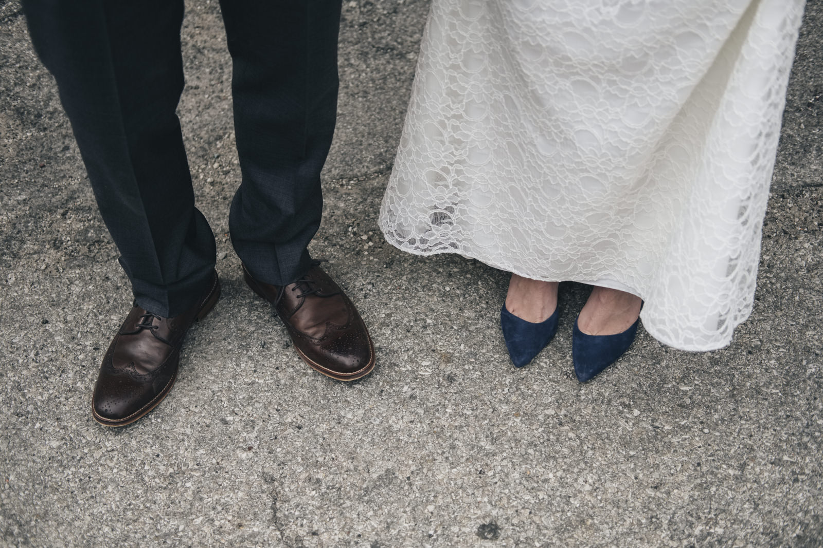 Wedding photography in downtown Toledo. Detail shot of the bride and groom's shoes.