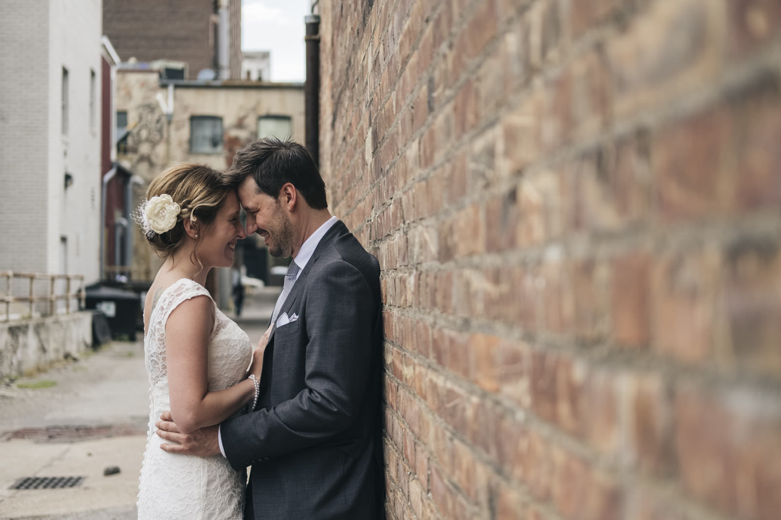 Bride and groom embrace during styled wedding session in Toledo ally.