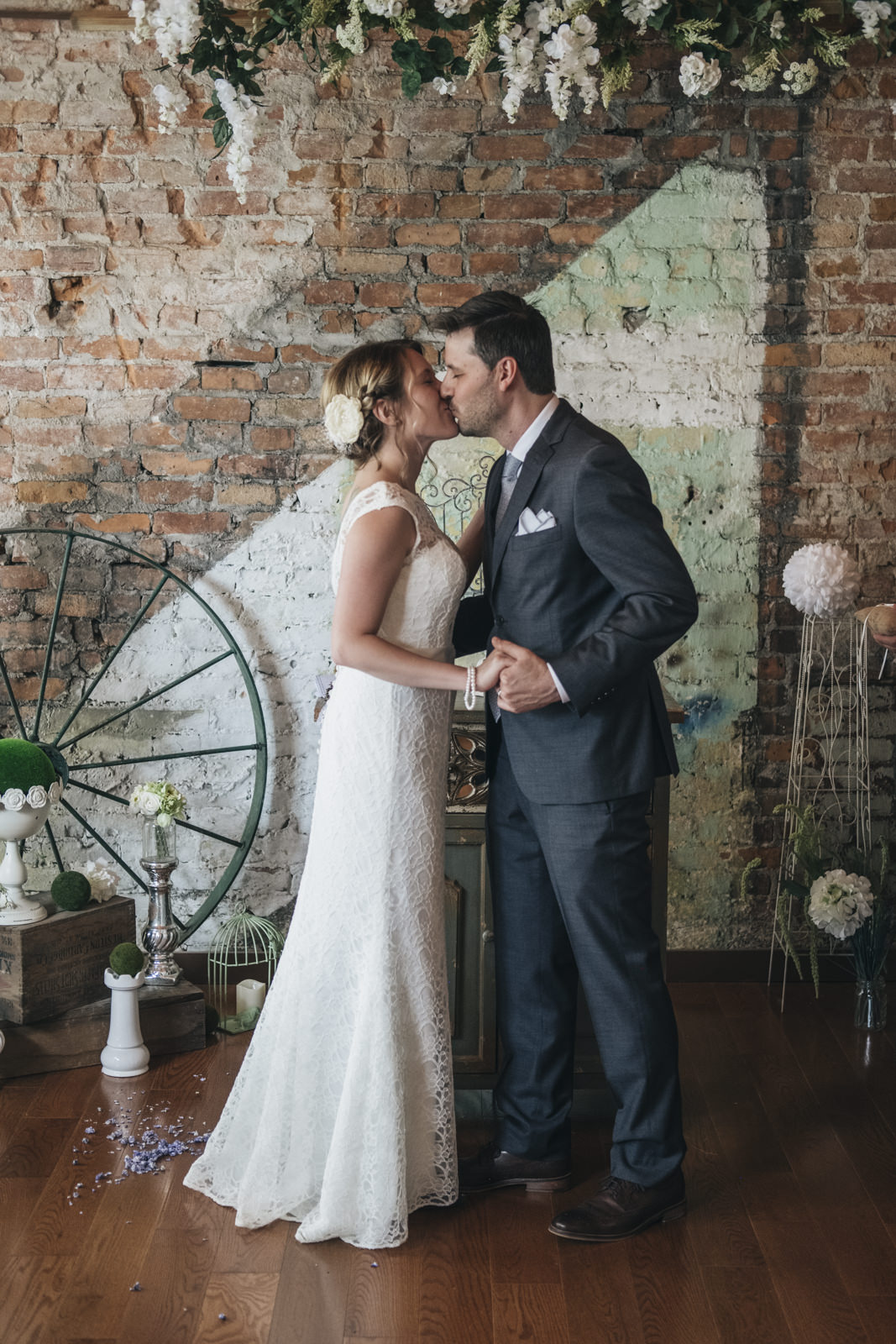 Bride and groom kiss during their urban wedding ceremony in Toledo, Ohio.