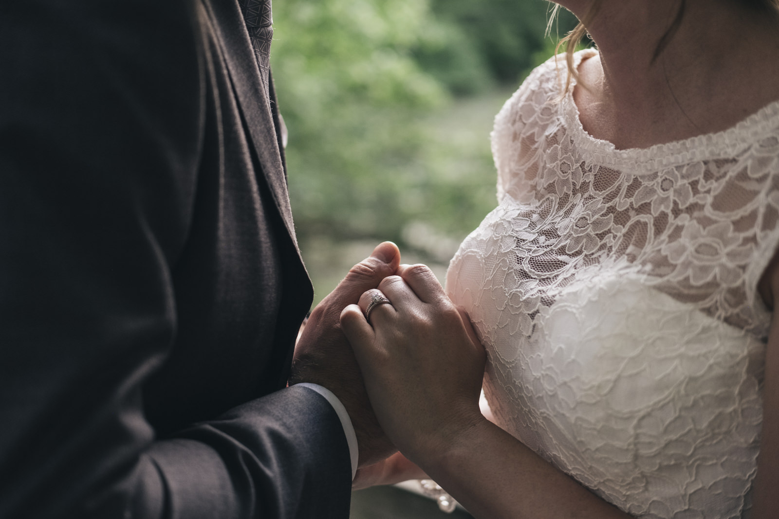 Up close detail picture of the bride and groom's hands on their wedding day.