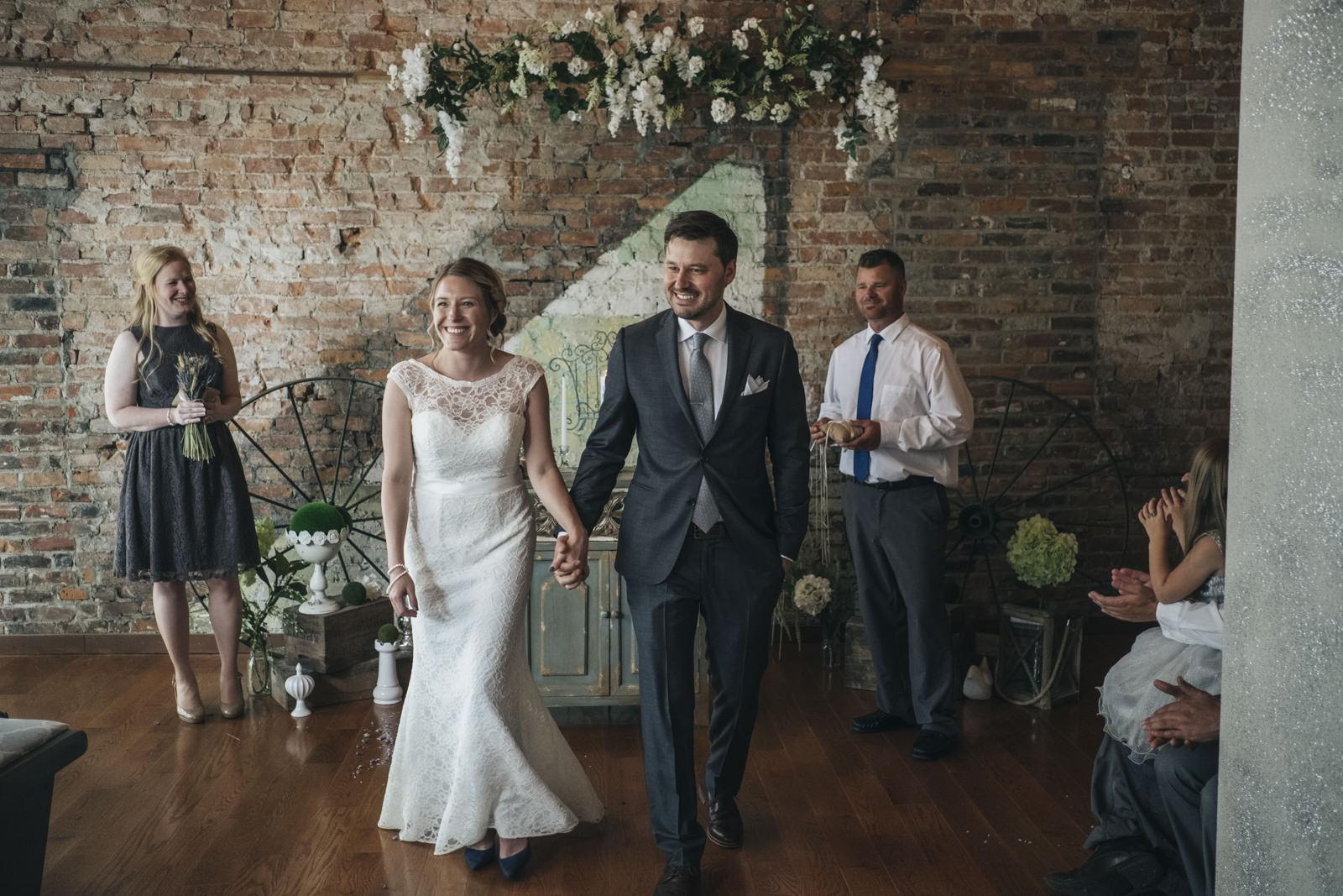 Bride and groom exit ceremony in Toledo, Ohio wedding.