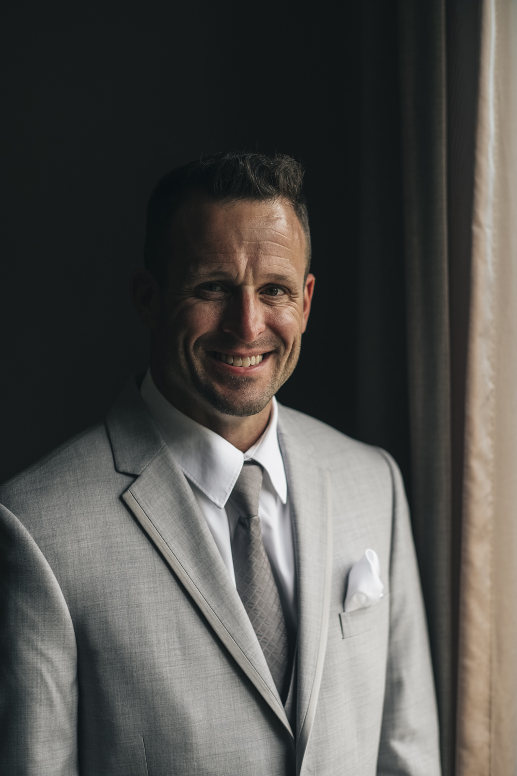 Portrait of a groom before his elopement.
