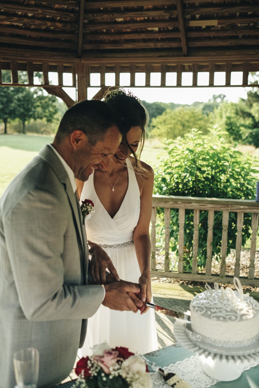 Bride and groom cutting the cake at their elopement.