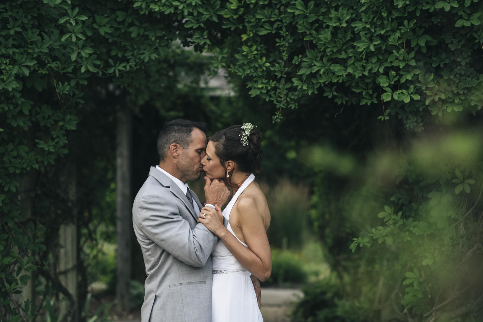 Bride and groom kiss during their bride & groom creative session.