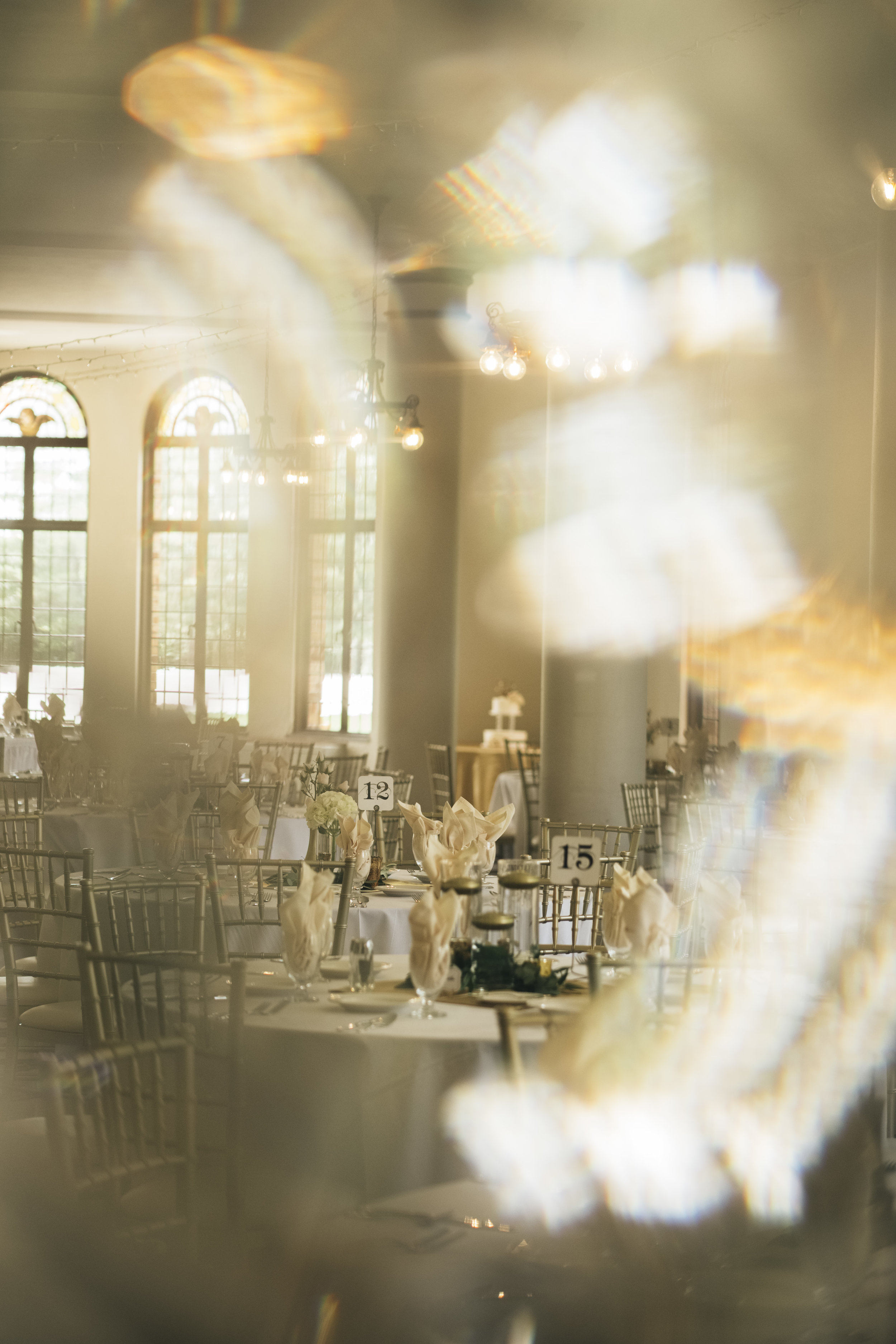 Nazareth Hall ballroom with green and golden accents.