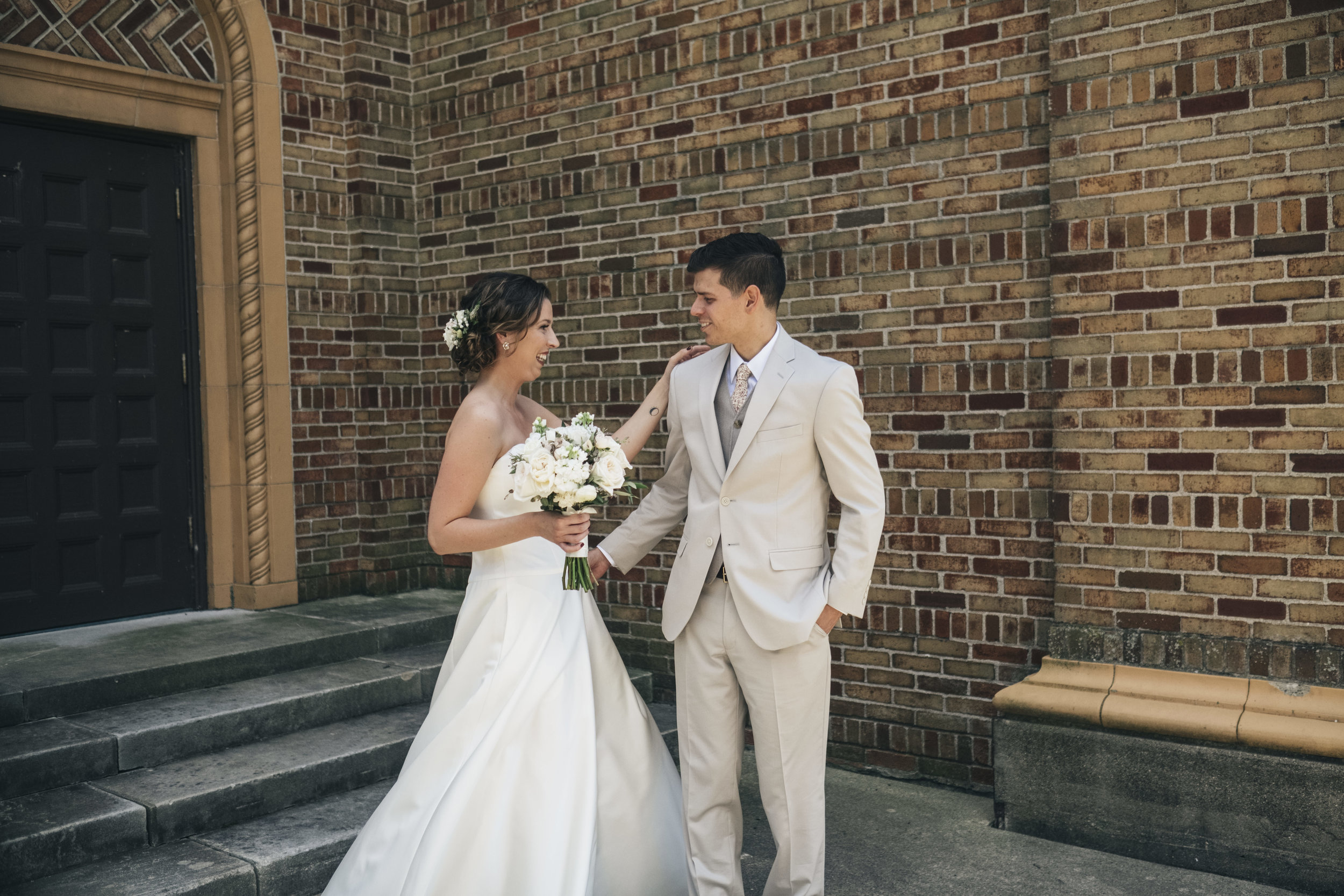 Bride and groom first look at Nazareth Hall.