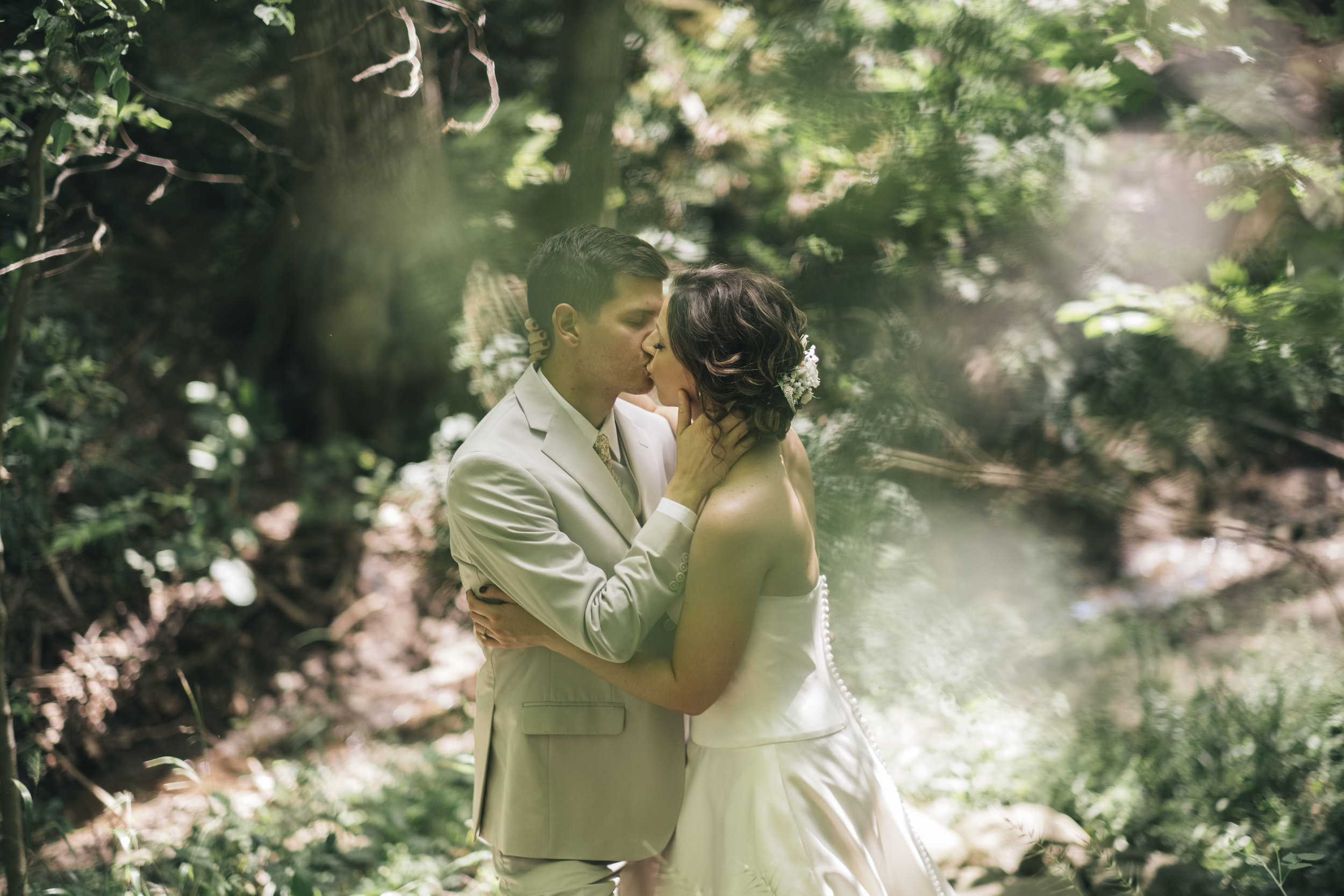 Bride and groom kiss during their creative session in Toledo, Ohio.