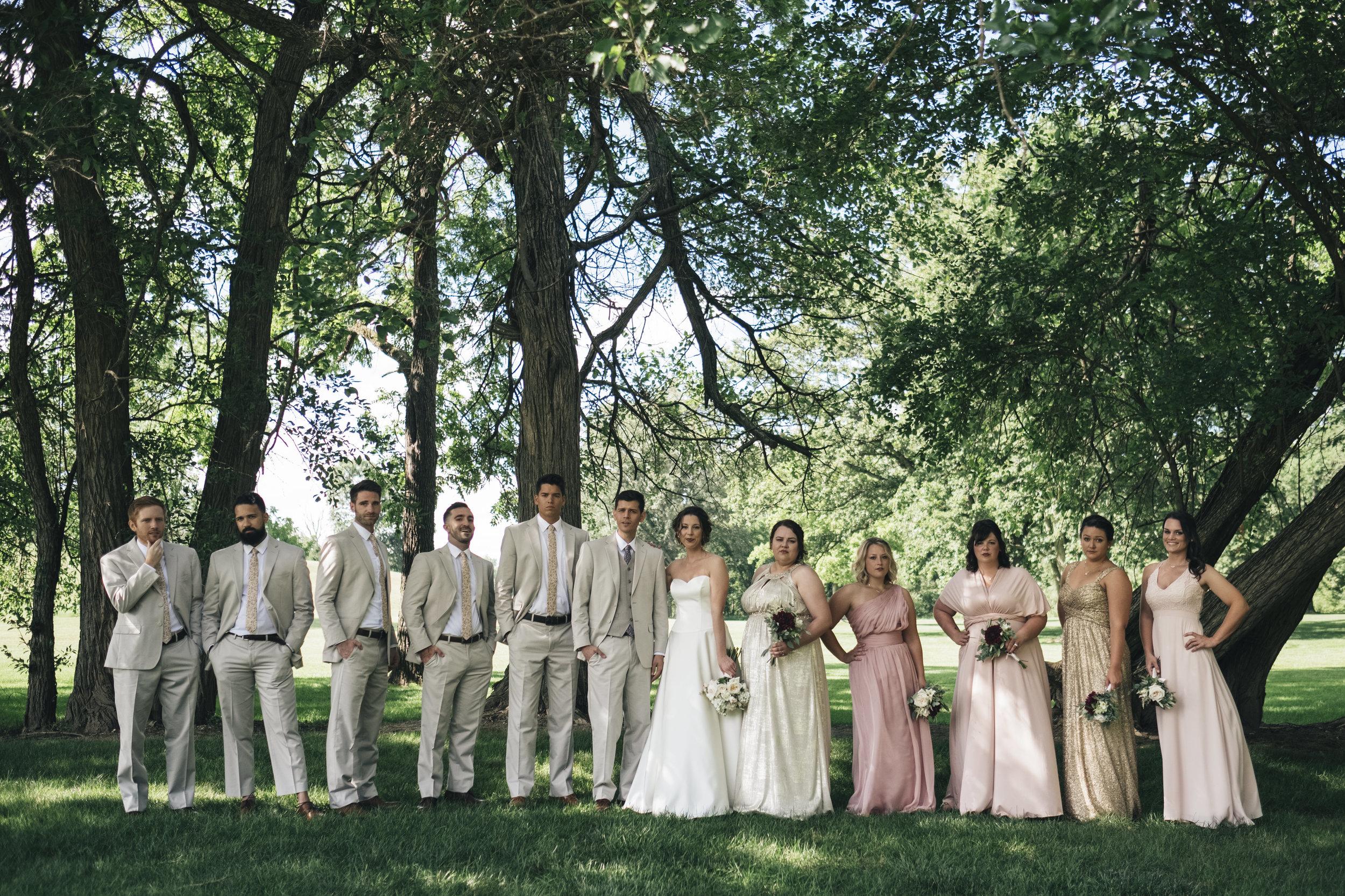 Bridal party outside Nazareth Hall.