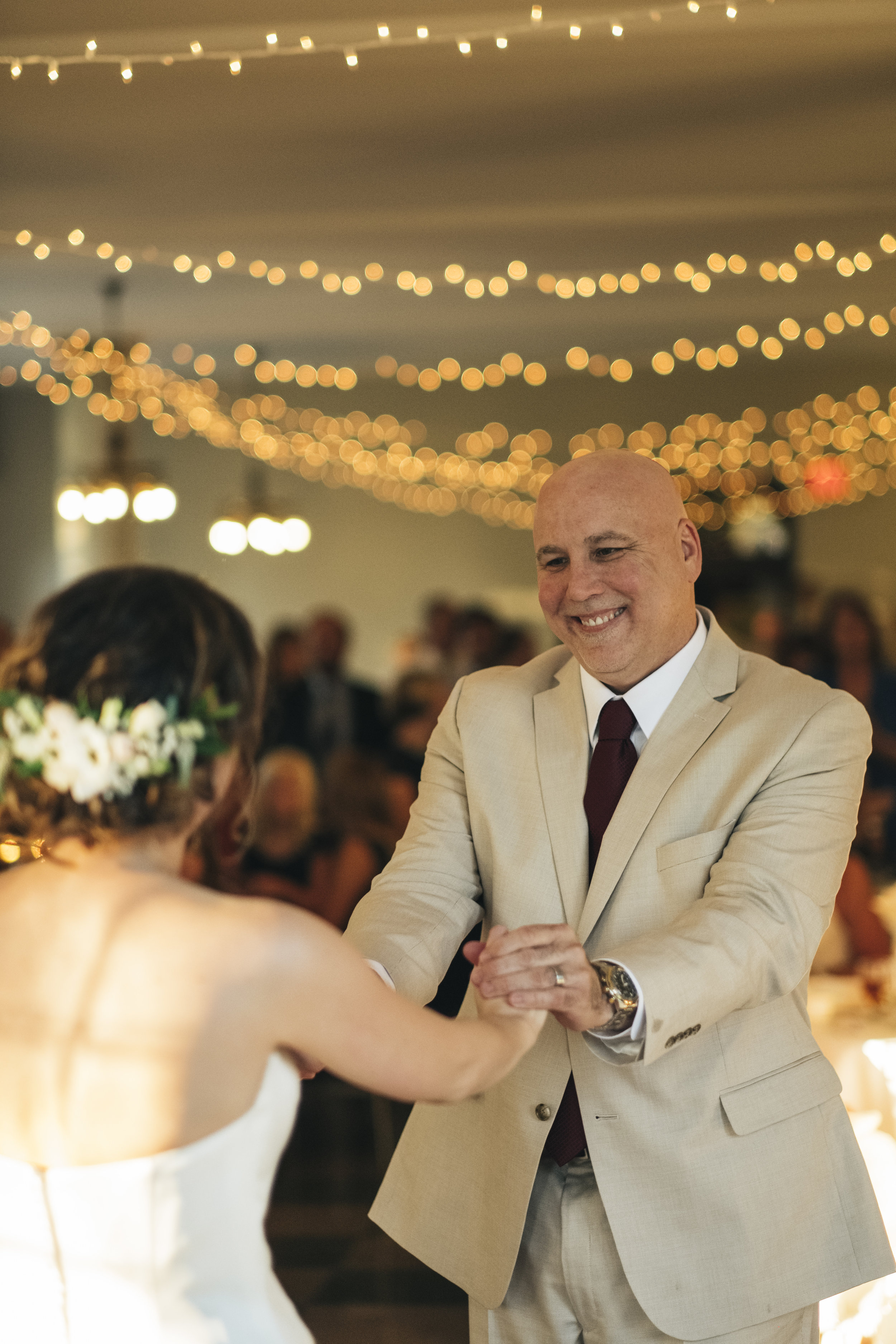 Father and daughter share in a first dance at Nazareth Hall wedding reception.