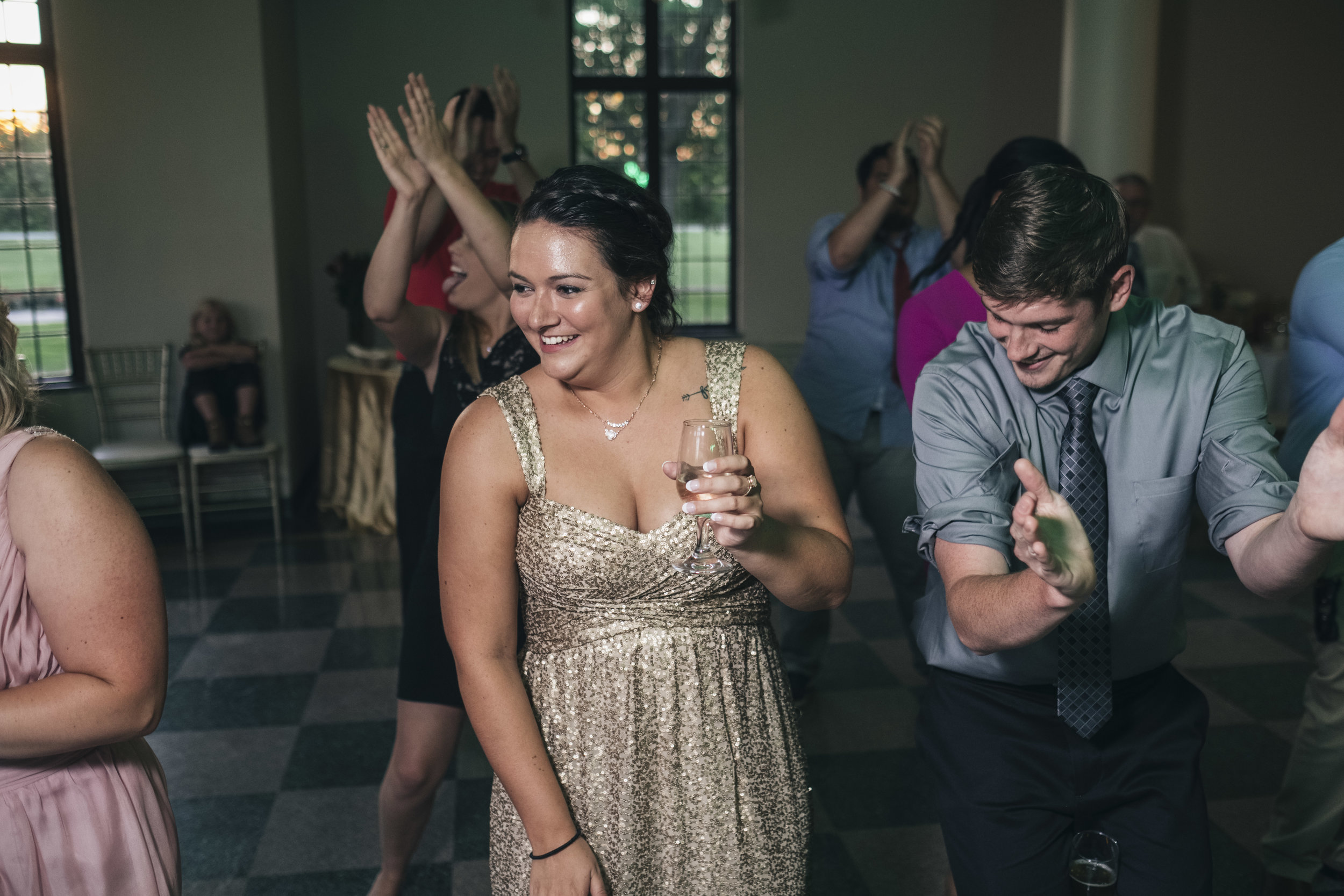 Bridesmaid dances at a wedding reception in Northwest, Ohio.