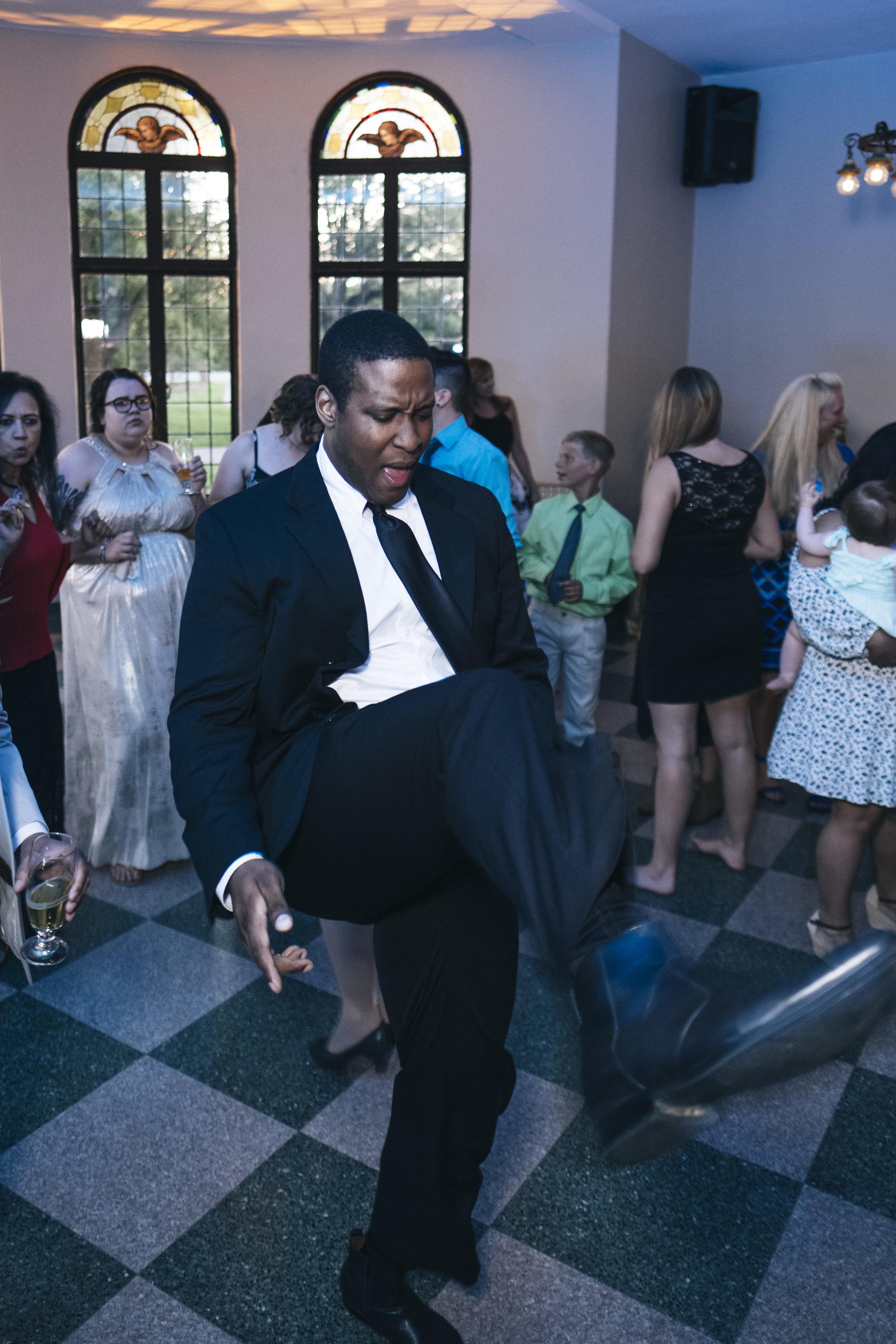 Man dances at a wedding reception in Grand Rapids, Ohio.