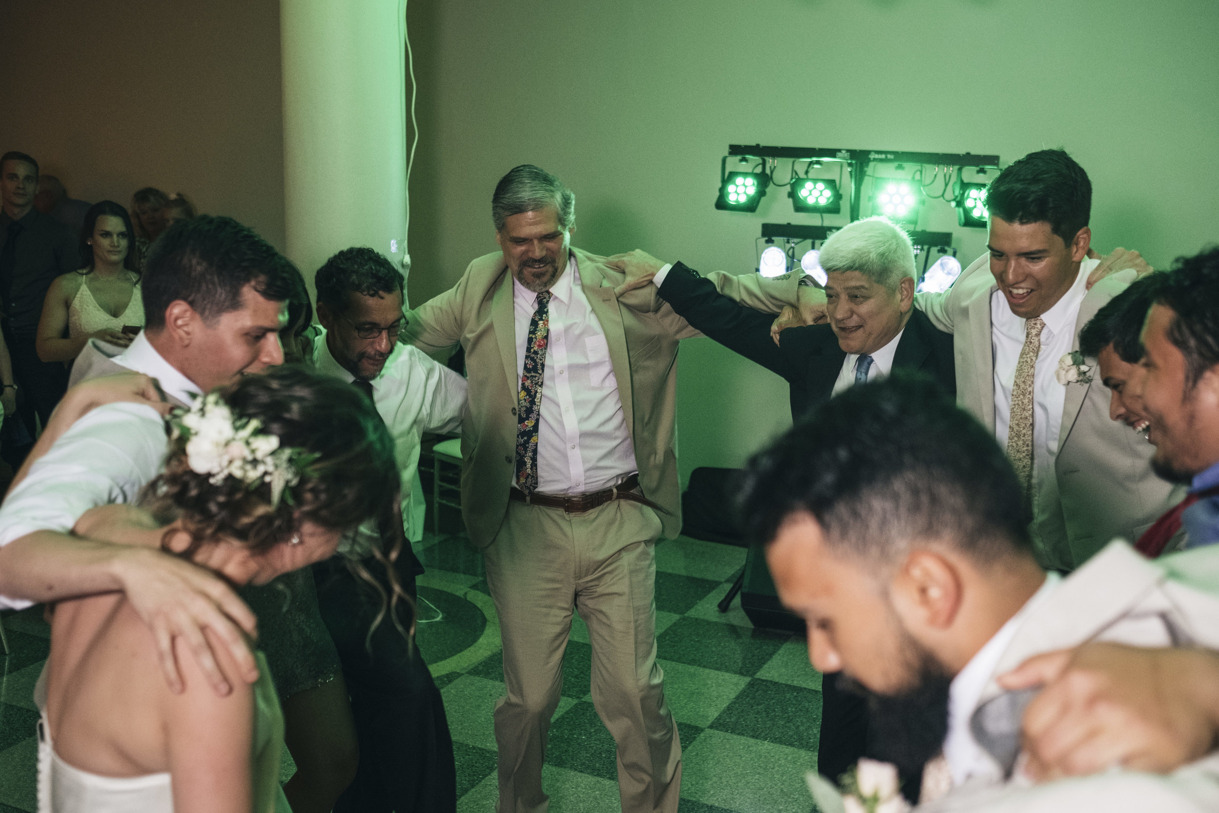 People dance at a wedding reception at Nazareth Hall.