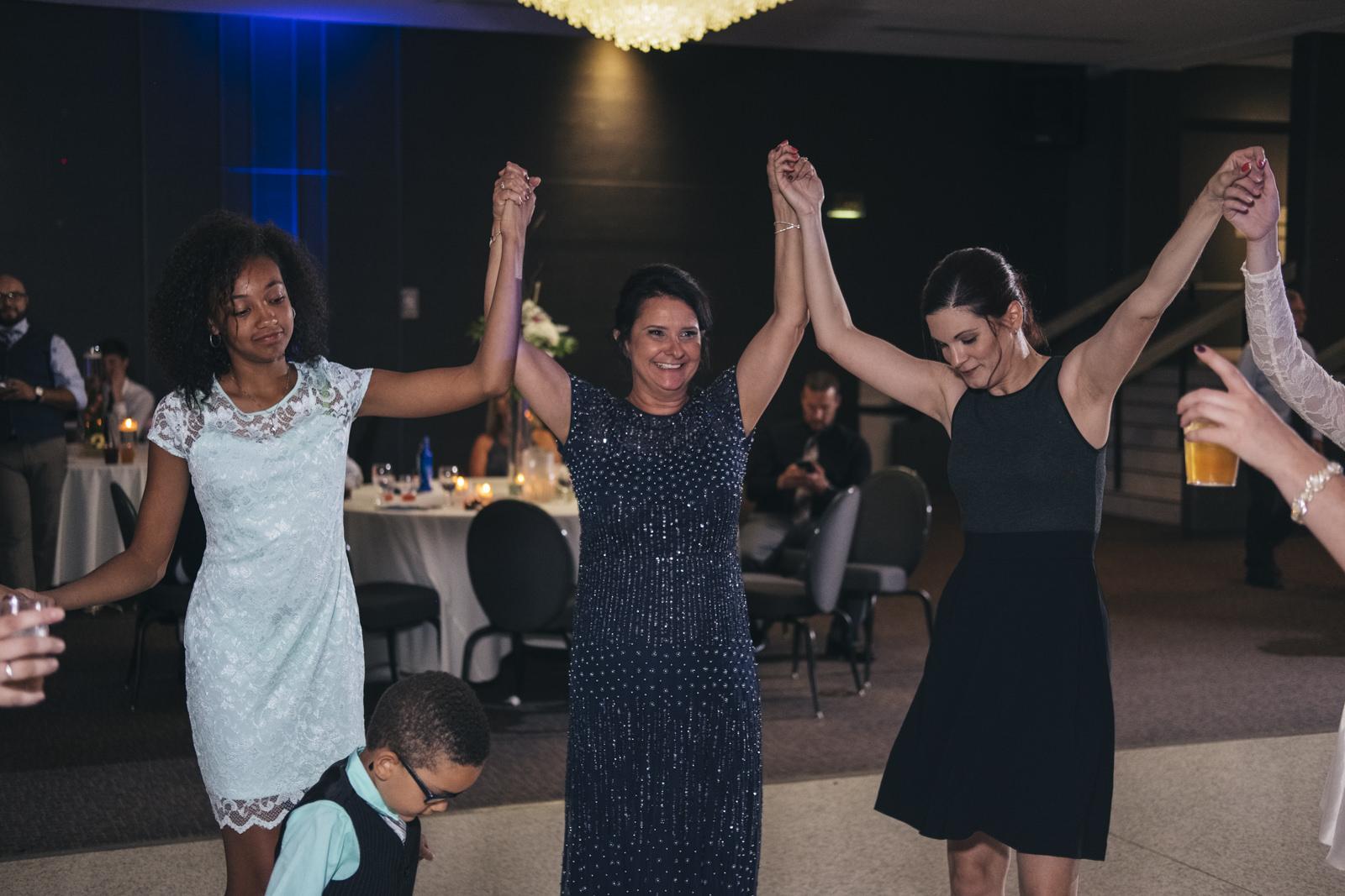 The groom's stepmom dances at his wedding reception in Toledo, Ohio.