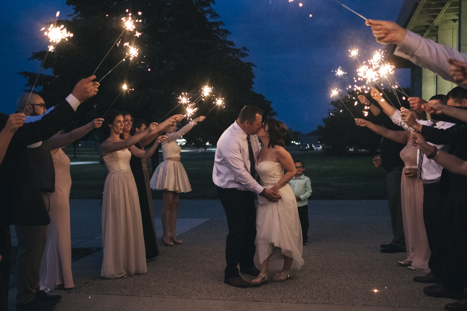 The bride and groom kiss during their sparkler exit in Toledo, Ohio.