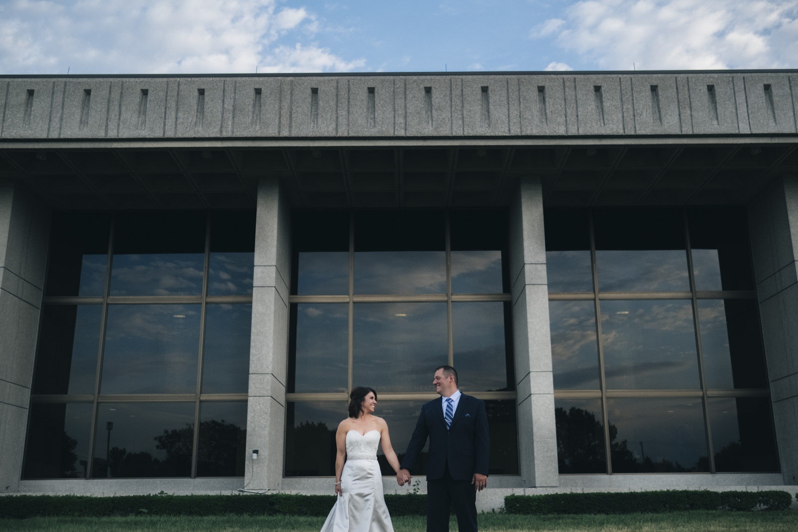 Bride and groom share an intimate moment in between their wedding ceremony and reception outside of Stranahan Theatre.