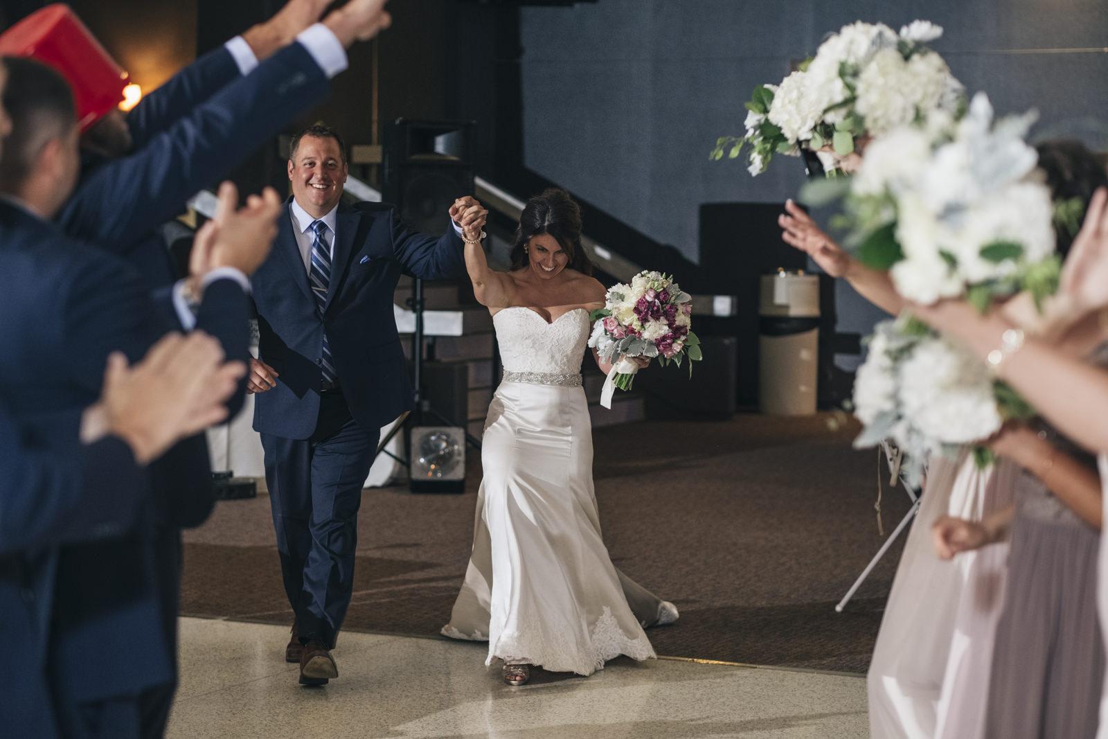Bride and groom enter their wedding reception in Toledo, Ohio.
