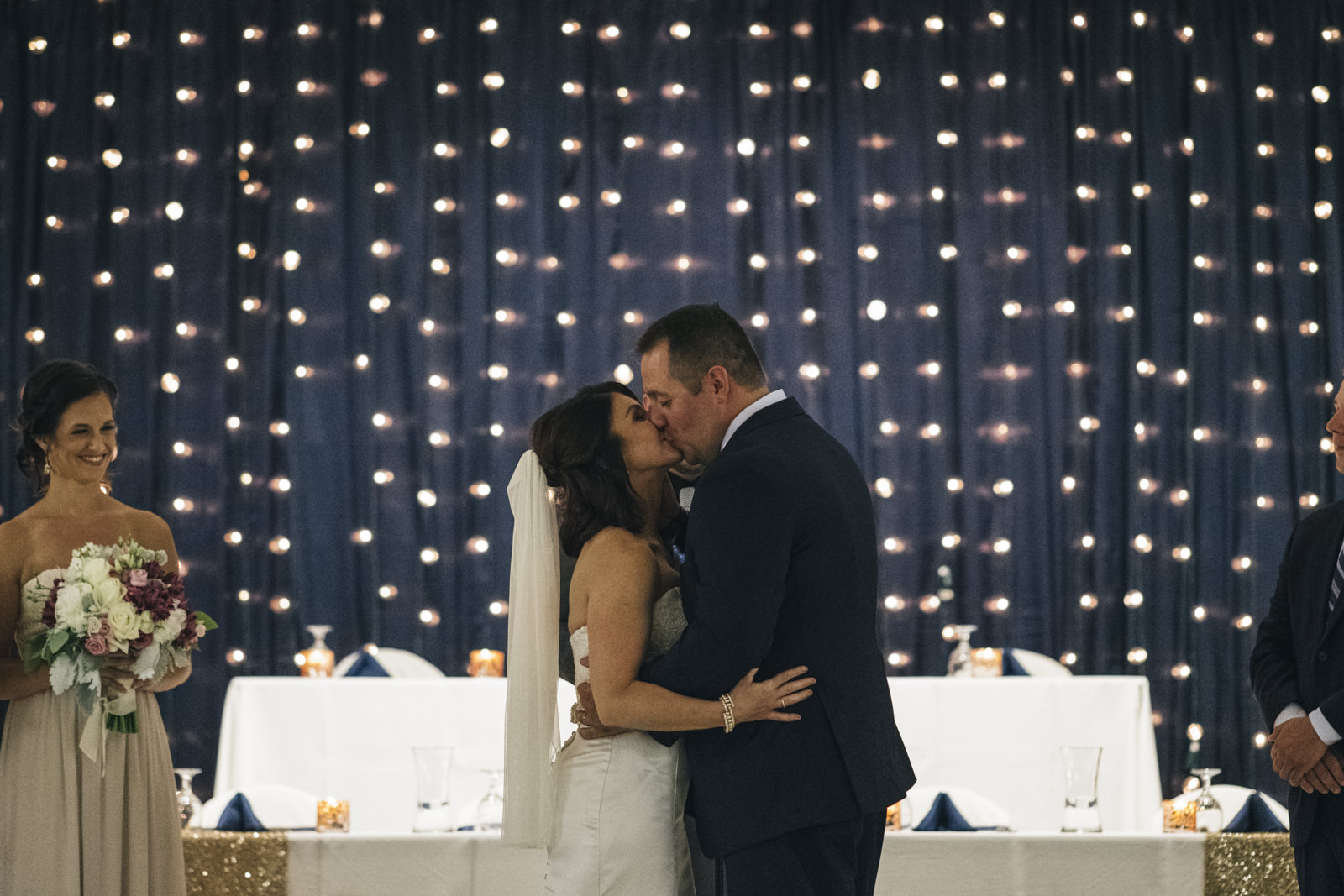Bride and groom share their first kiss at their wedding ceremony at the Stranahan Theatre.