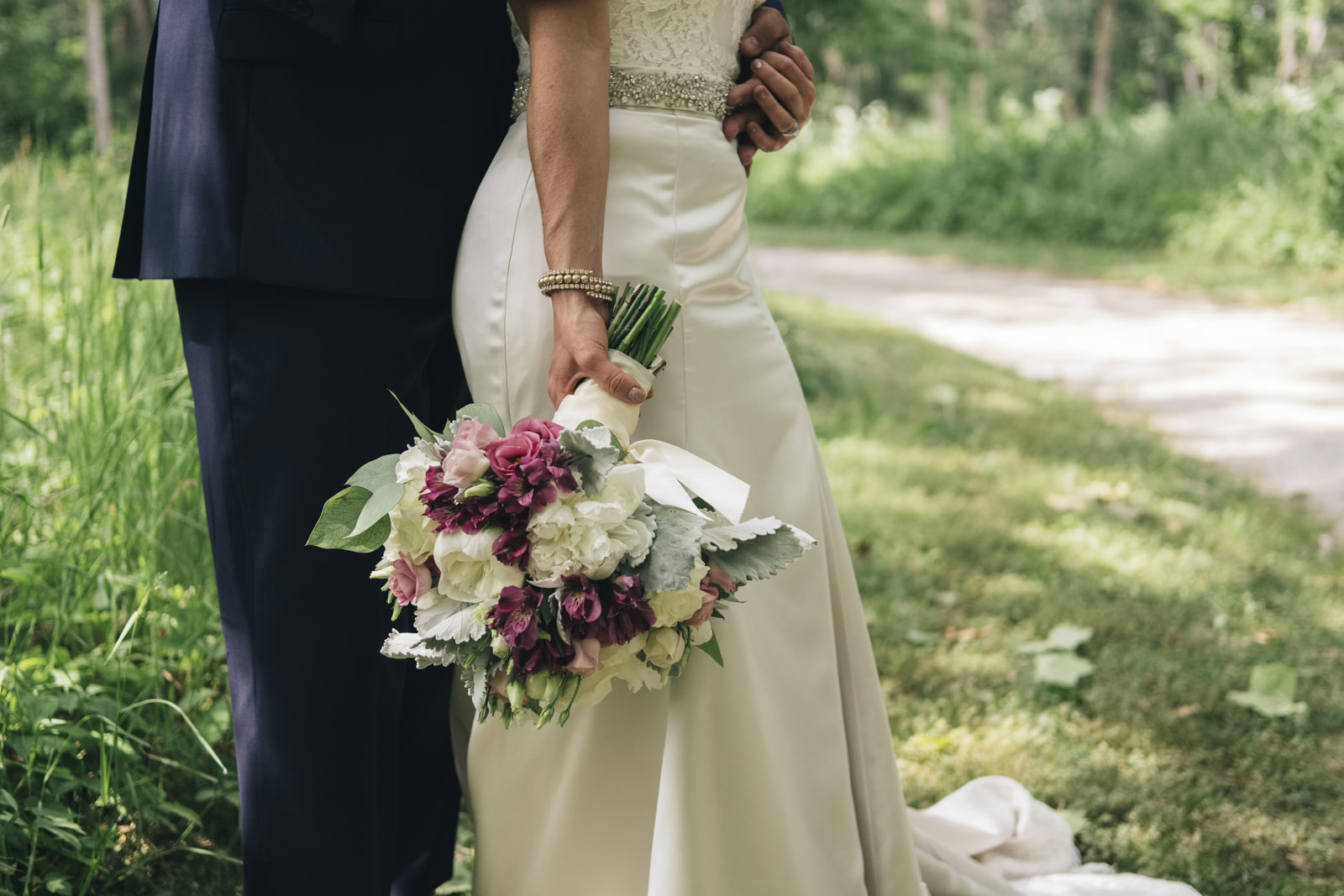 Picture of the bride and groom before their wedding ceremony at Swan Creek MetroPark in Toledo, Ohio.