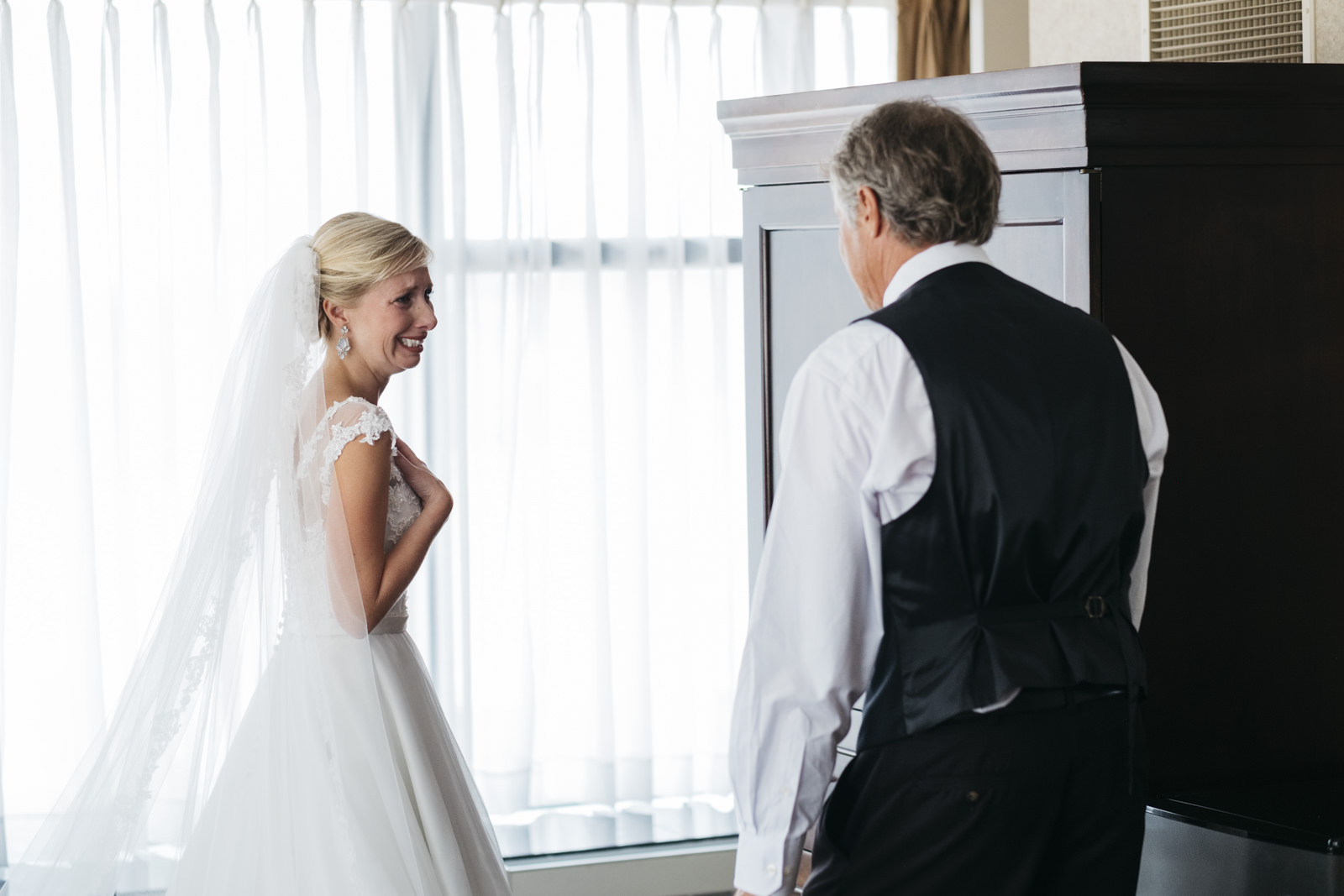 Bride sees her father for the first time on her wedding day.