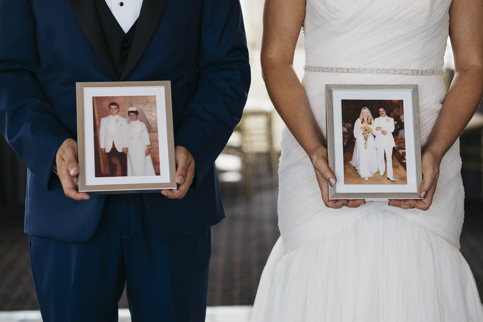 Family members of the bride and groom in picture frames.