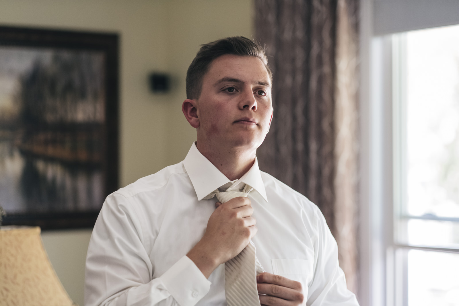 Groom getting ready on wedding day in Sylvania, Ohio.