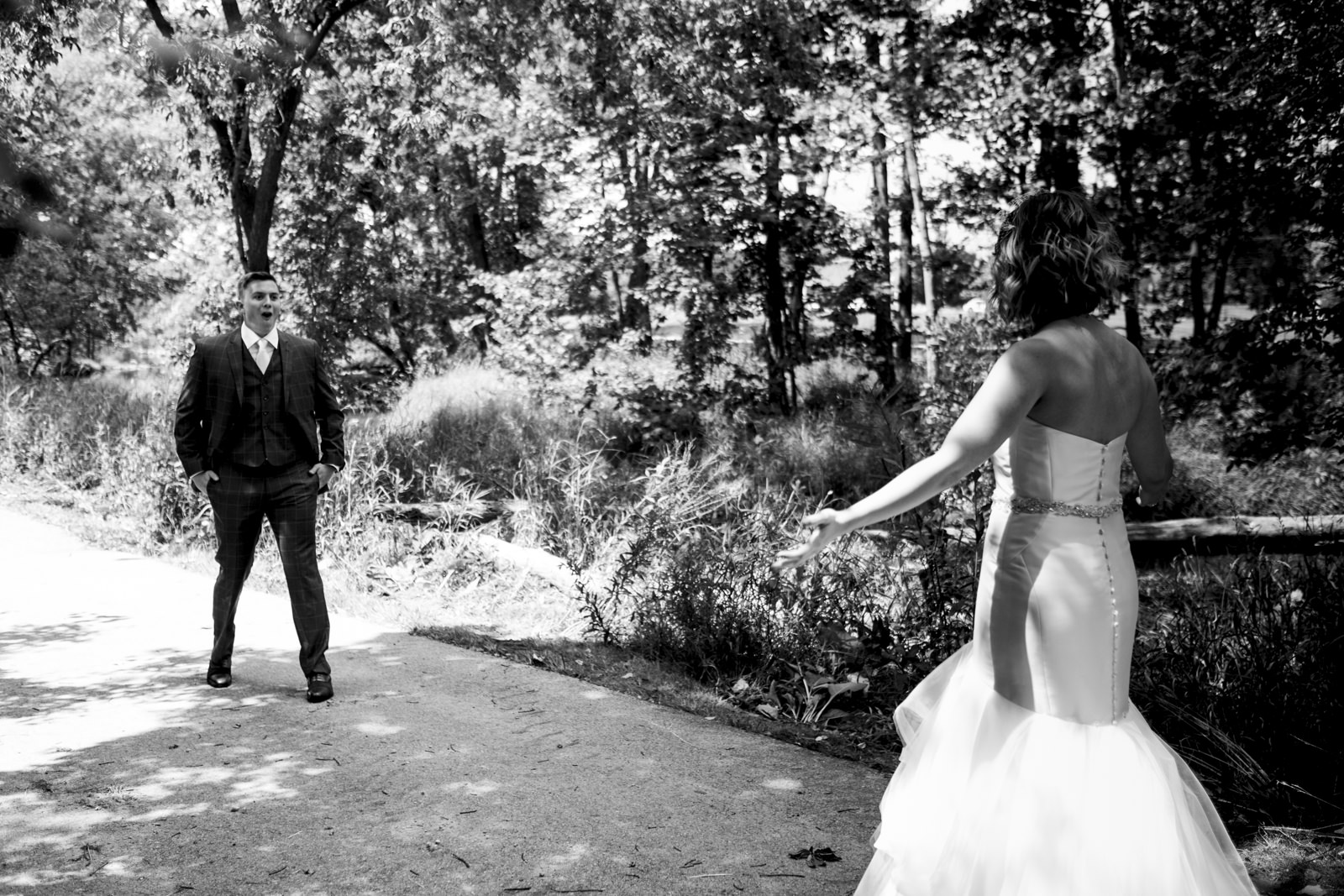 Groom's sweet reaction to seeing his bride for the first time on their wedding day.