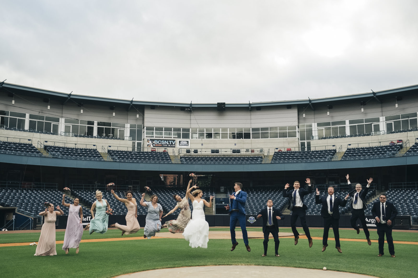 Bridal party wedding photography inside the Toledo Mudhen's Stadium by Hensville.