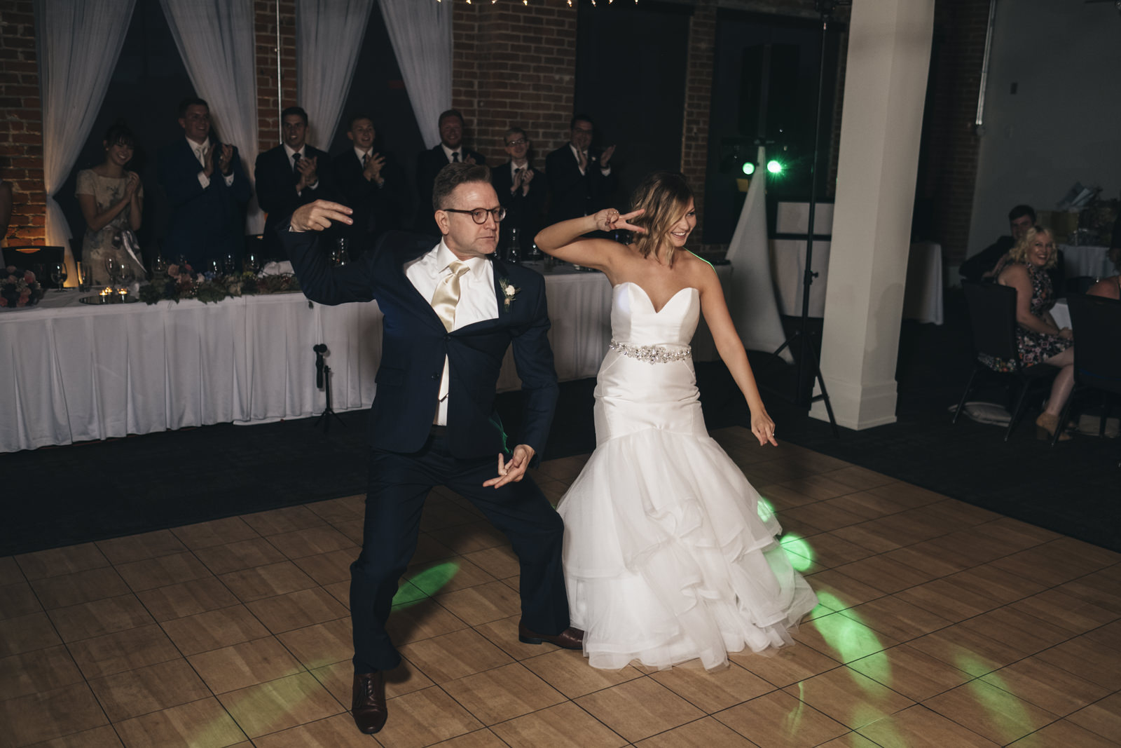Bride and her father do a fun dance at wedding reception.