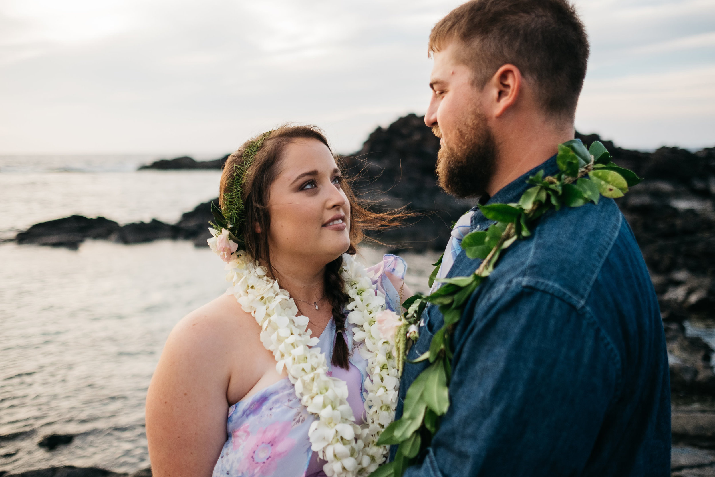 Bride and groom share an intimate moment after their wedding in Hawaii.