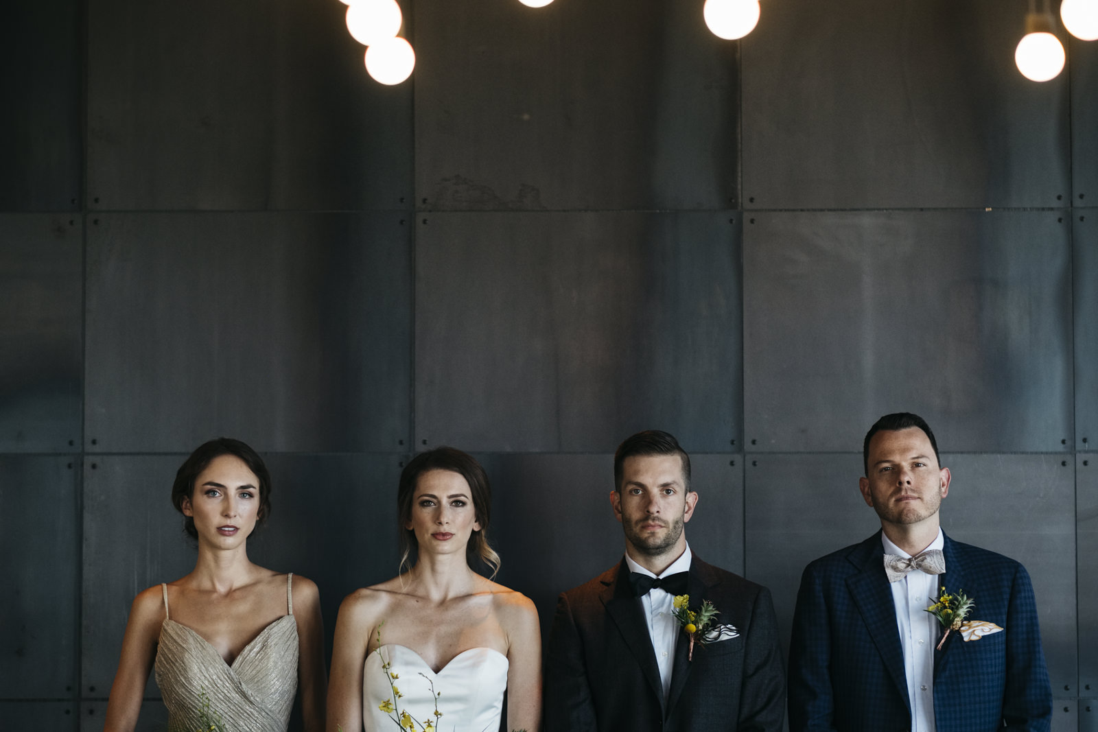 Bridal party poses for a group shot in the Renaissance Hotel in Toledo.